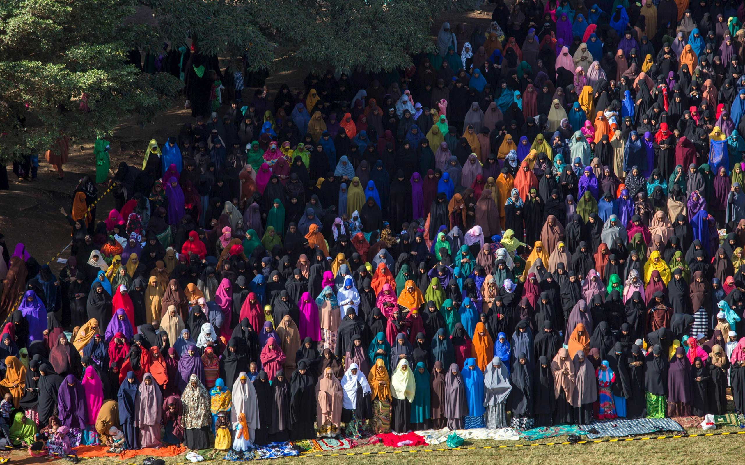 Muslim faithful take part in morning prayers to celebrate the first day of the Muslim holiday of Eid-al-Fitr, marking the end of the holy month of Ramadan, at the Eastleigh High School in Eastleigh, a suburb in Nairobi predominantly inhabited by Somali immigrants within Kenya's capital Nairobi, on July 17, 2015.