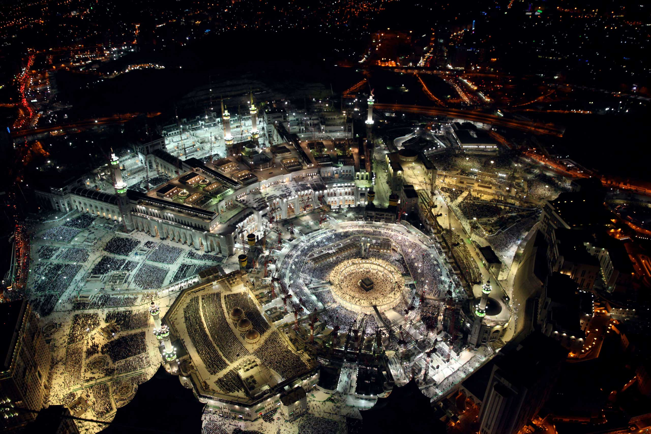 A picture taken from the Abraj al-Bait Towers, also known as the Mecca Royal Hotel Clock Tower, shows Muslim worshipers praying at the Grand Mosque in the Muslim holy city of Mecca, a day before the end of the fasting month of Ramadan, on July 16, 2015.