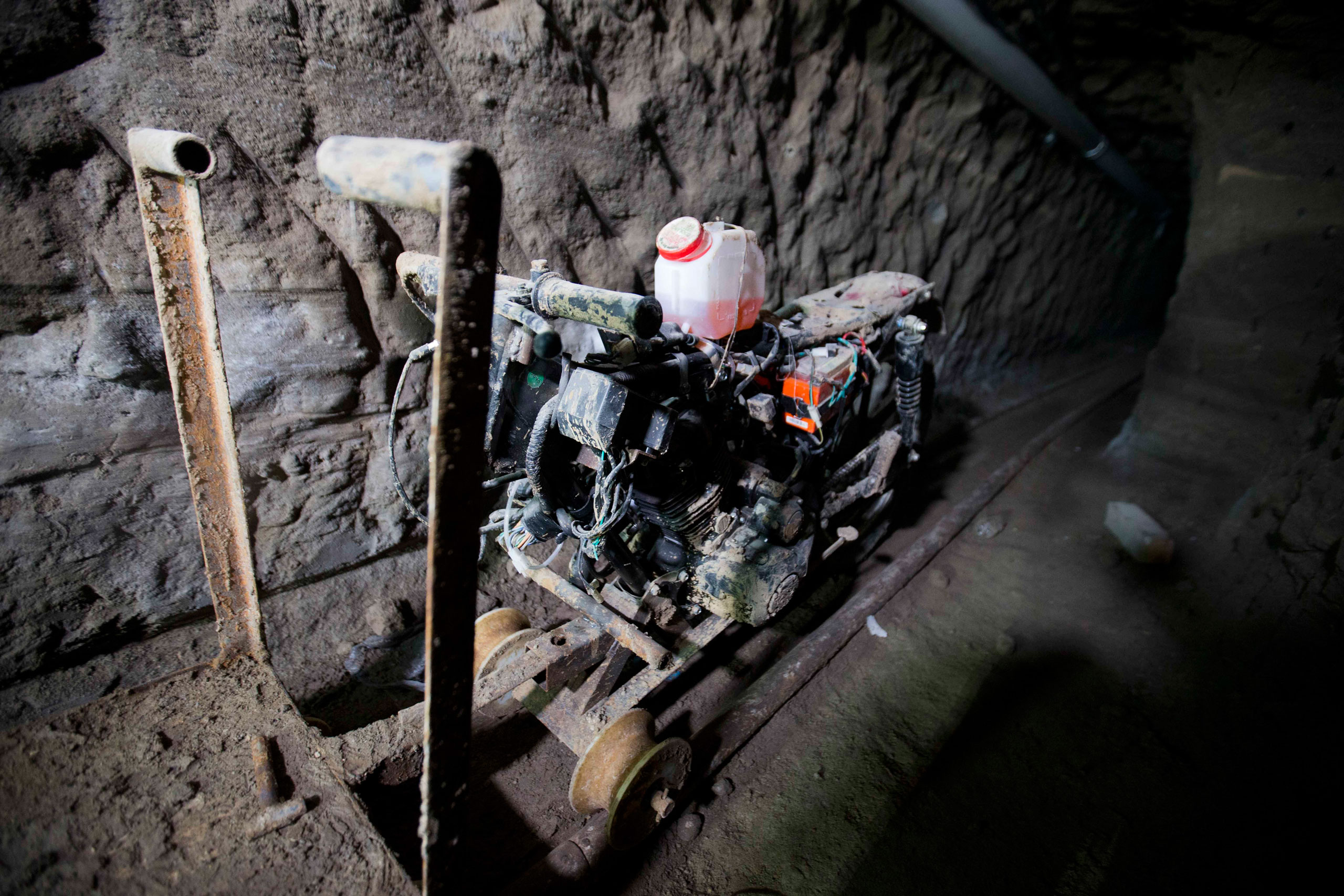 A motorcycle adapted to a rail is seen under the half-built house where drug lord Joaquin  El Chapo  Guzman made his escape through a tunnel in Almoloya, Mexico, on July 14, 2015.