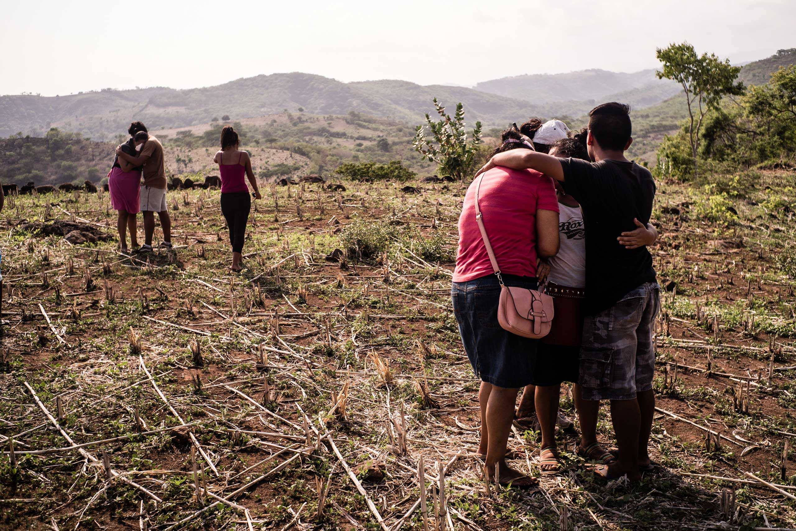 Relatives of a man believed to have been killed                                and buried by a gang in the town of La Libertad                                wait for officials to exhume his body, on May 28, 2015.