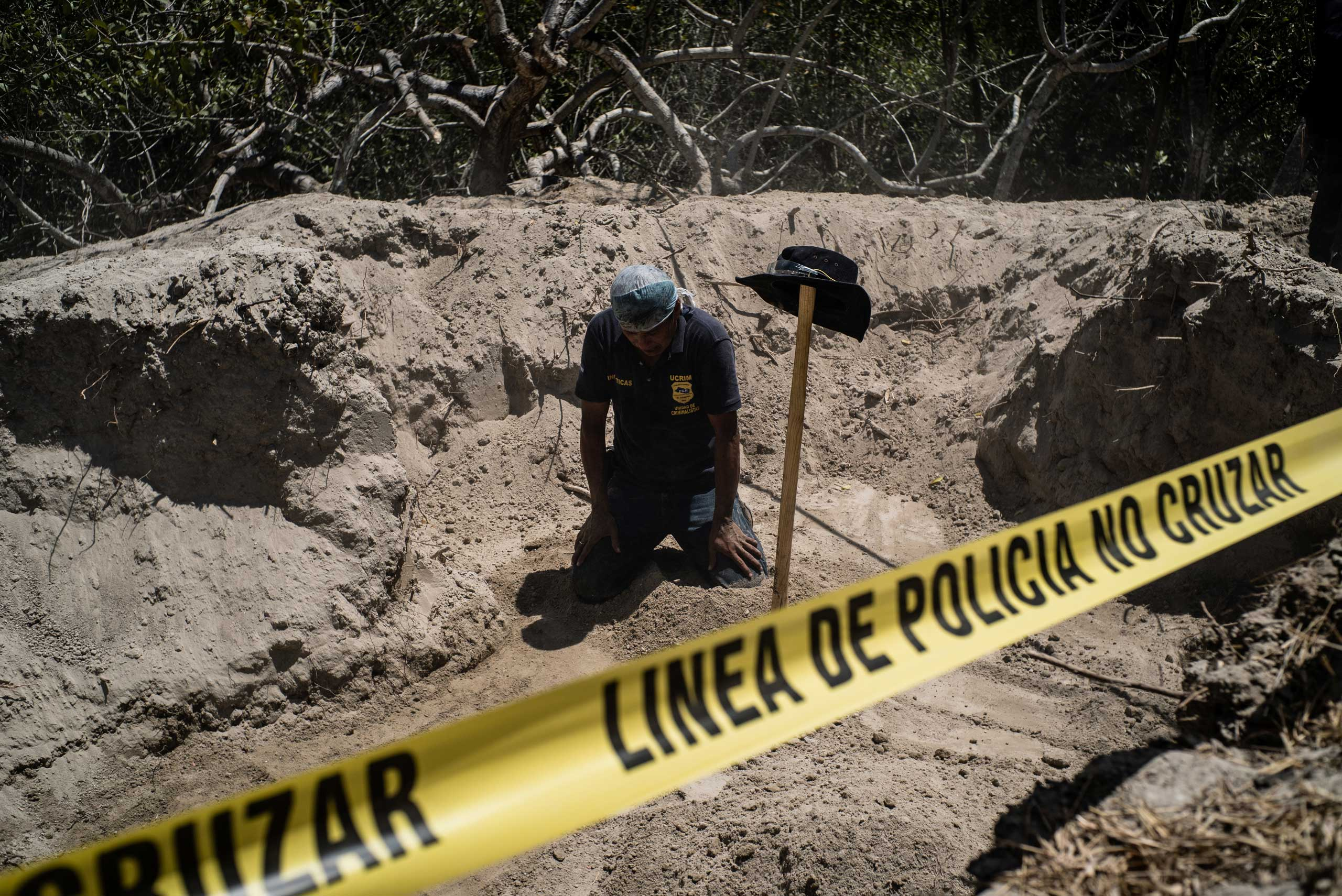 Forensic anthropologist Ticas Israel looks for clues as to where the bodies of three young victims are buried, in Herradura, March 18, 2015.