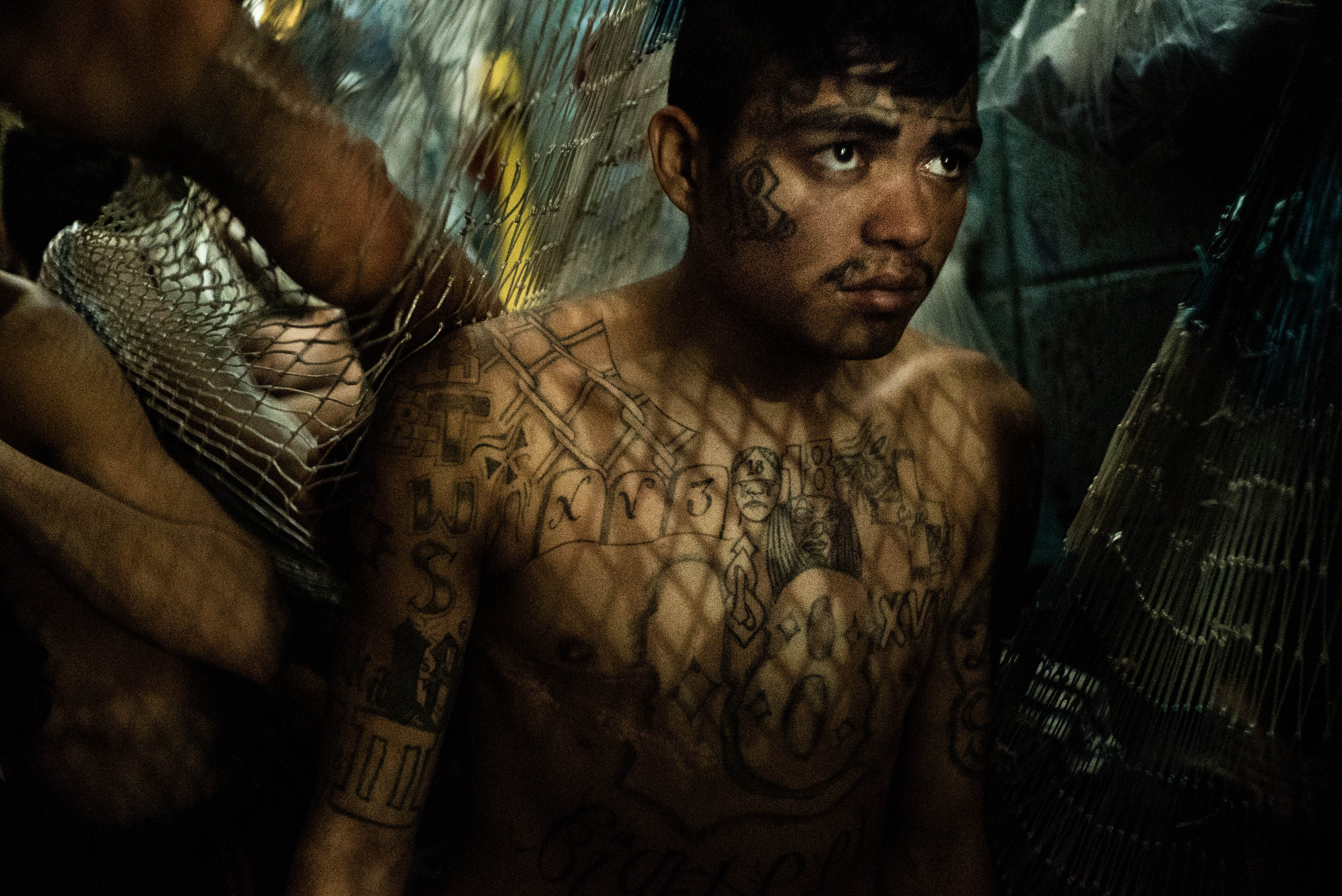 A suspected gang member in a crowded jail in San Salvador.