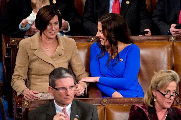 Reps. Elise Stefanik, R-N.Y., right, and Mimi Walters, R-Calif., are pictured during the election for Speaker before the 114th Congress was sworn in on the House floor, January 6, 2015.