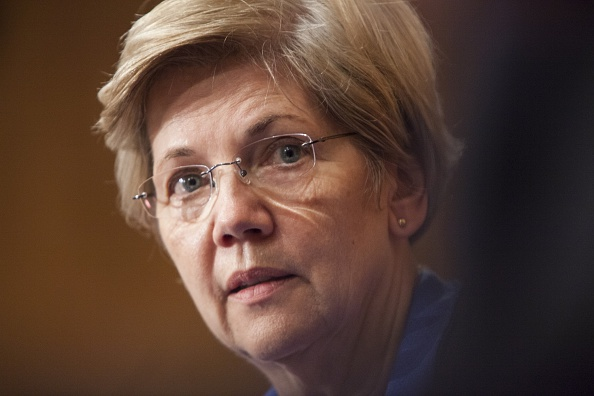 Senator Elizabeth Warren listens to Janet Yellen's testimony during a Senate Banking, Housing, and Urban Affairs Committee during a hearing on The Semiannual Monetary Policy Report to the Congress.