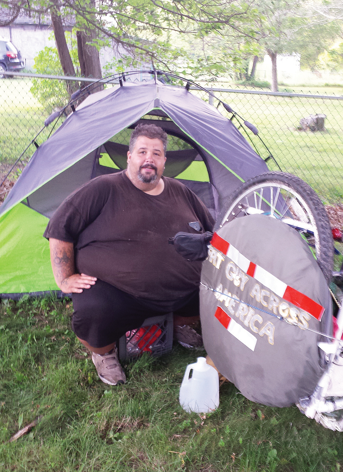 Eric Hites, rests at the Bliss Congregational Church in Tiverton, R.I on July 21, 2015, while he waits for a new bicycle so he can continue his cross-country ride. The about 560-pound man is biking across the United States to lose weight.