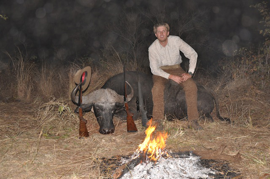 Eric Trump, son of Donald Trump, posing with a buffalo in Zimbabwe during a safari trip in 2012.