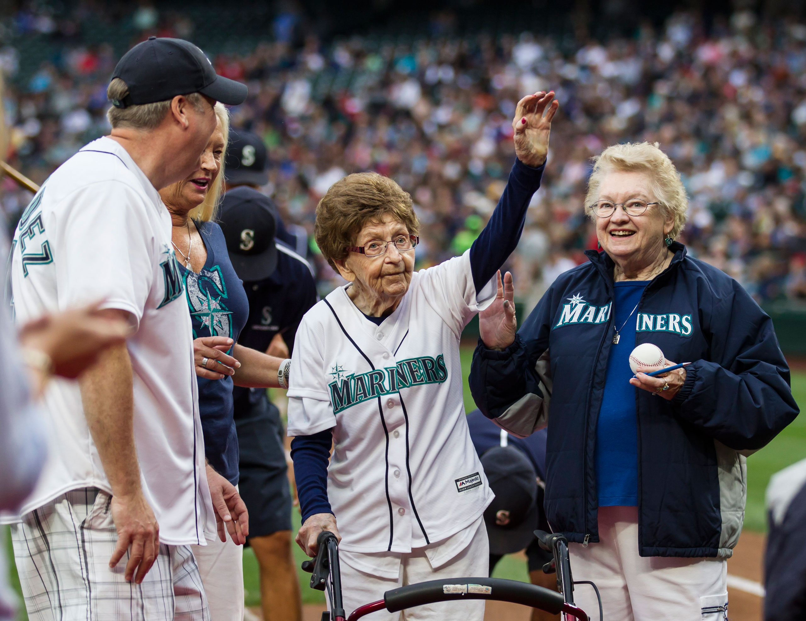 108-year-old Evelyn Jones of Woodinville, Wash., waves to the crowd after throwing out the ceremonial first pitch on her birthday before a baseball game between the Seattle Mariners and the Los Angeles Angels, in Seattle, on July 11, 2015.