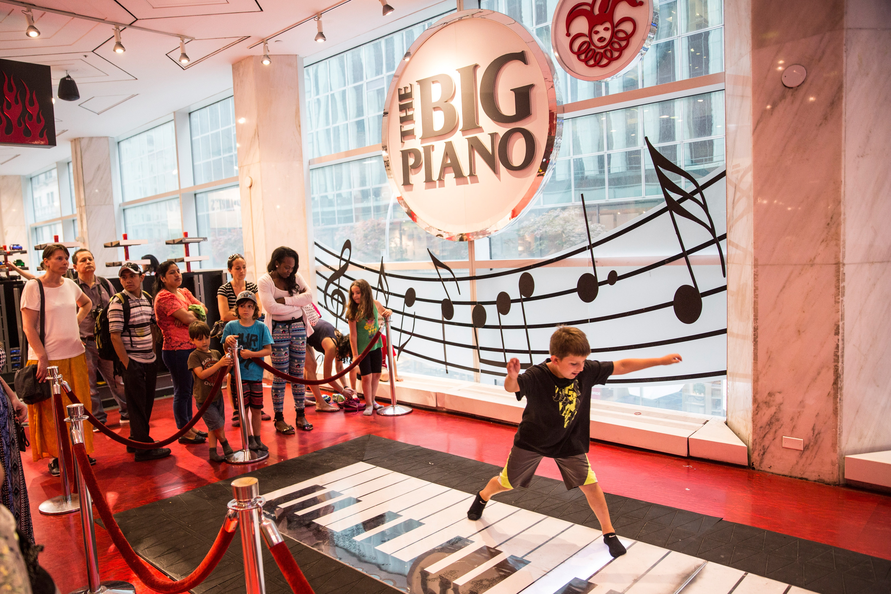 Children play on the  Big Piano,  made famous by the movie Big, in FAO Schwarz toy store on July 14, 2015 in New York City.