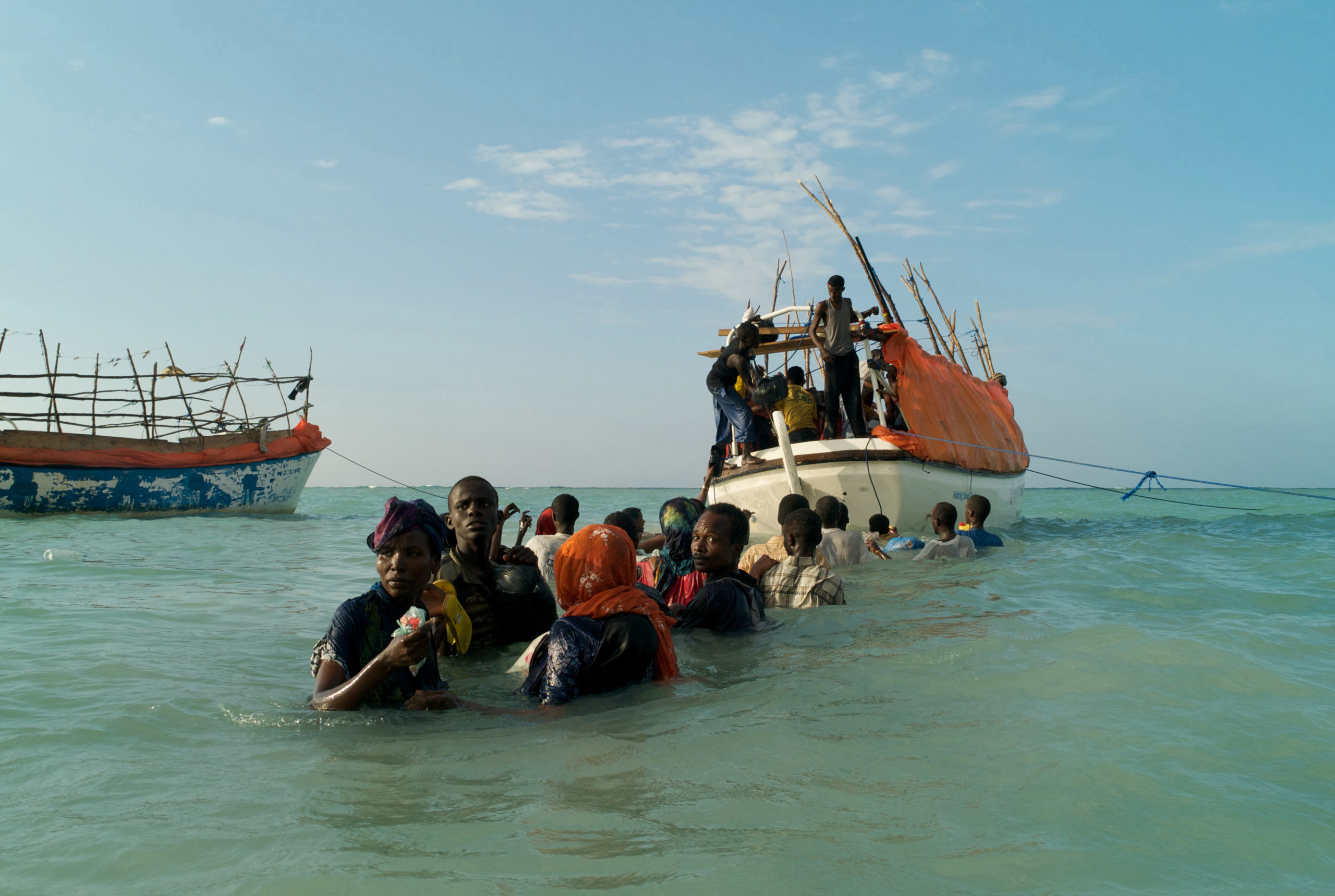 Somali refugees departing Shimbiro Beach to board  smuggler's boats to Yemen. From the series  A Million Shillings - Escape from Somalia