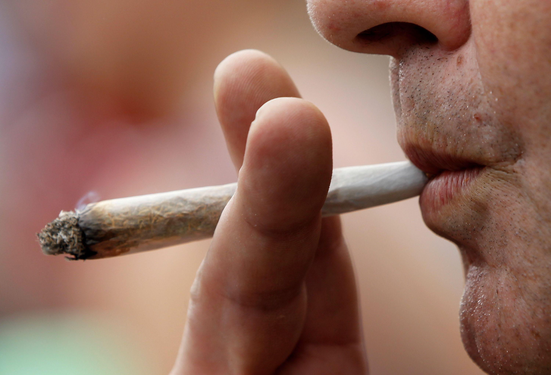 A man smokes licenced medicinal marijuana.