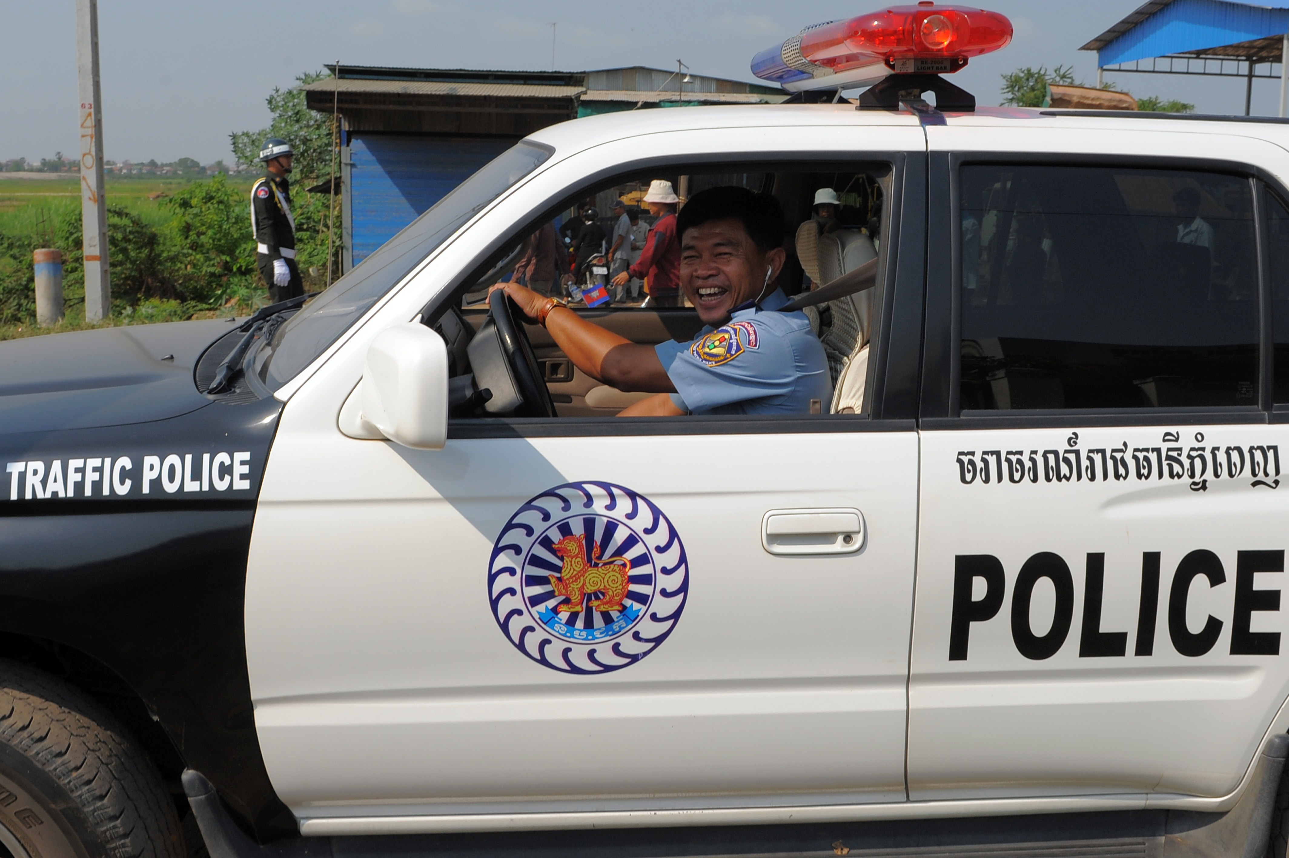 A Cambodian traffic police officer drives a car during a ceremony in Phnom Penh on Feb. 14, 2012