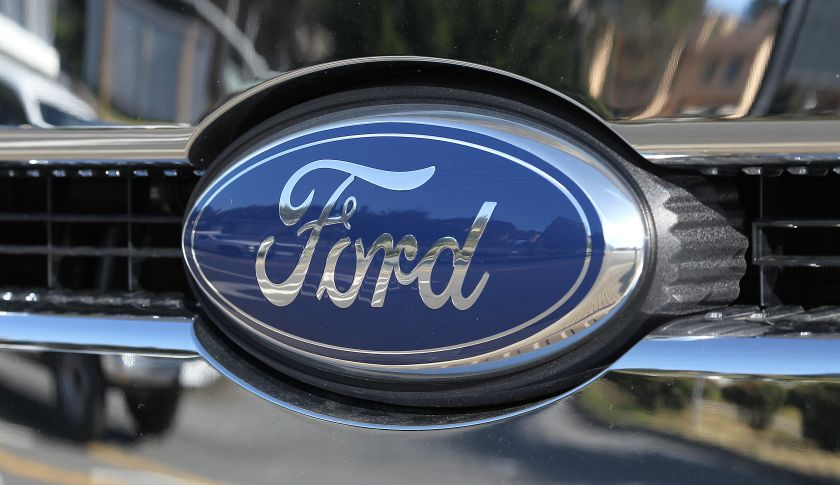 The Ford logo is seen on a brand new Ford truck.