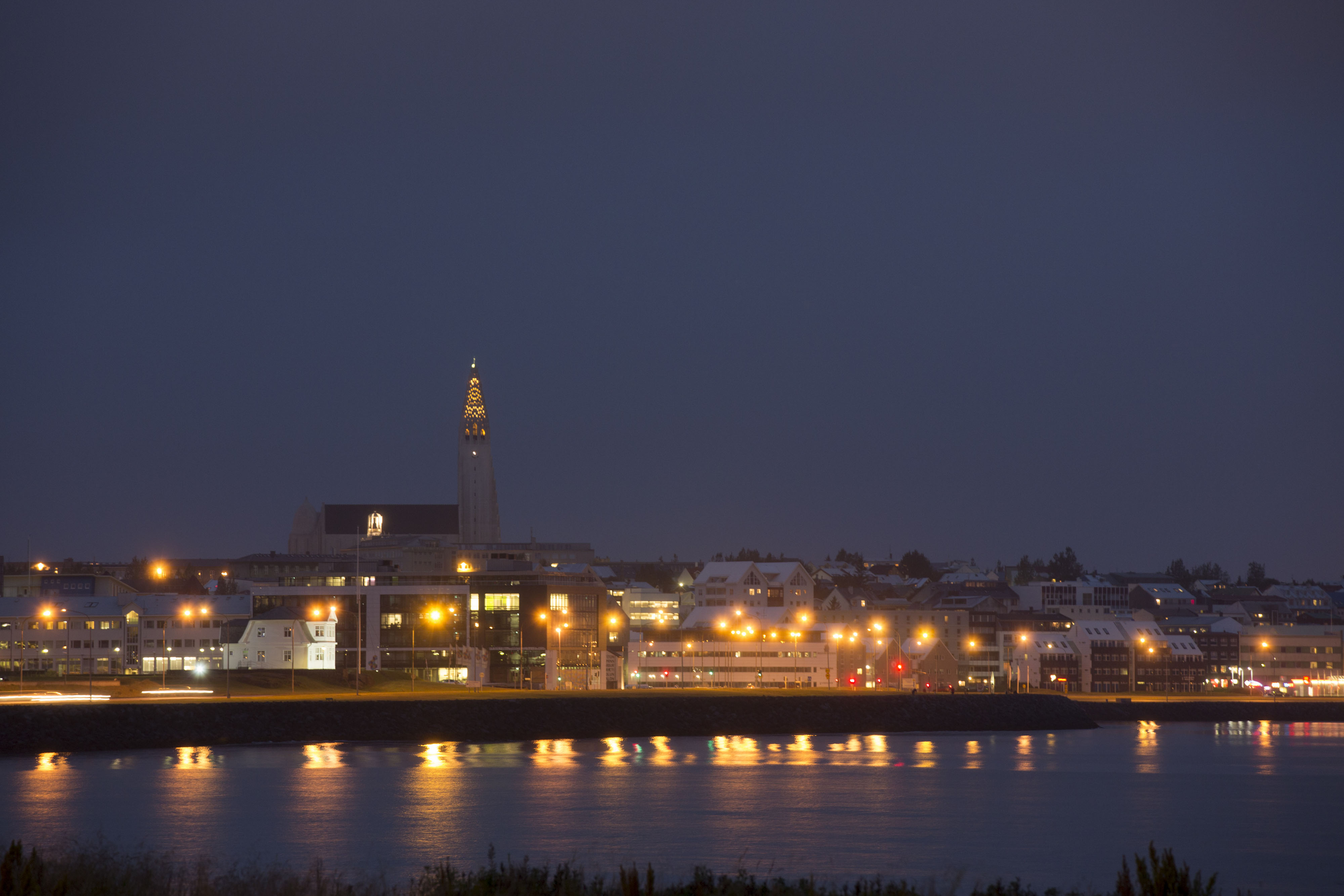The city skyline is seen illuminated by lights at night in Reykjavik, Iceland, on Friday, Aug. 10, 2012.