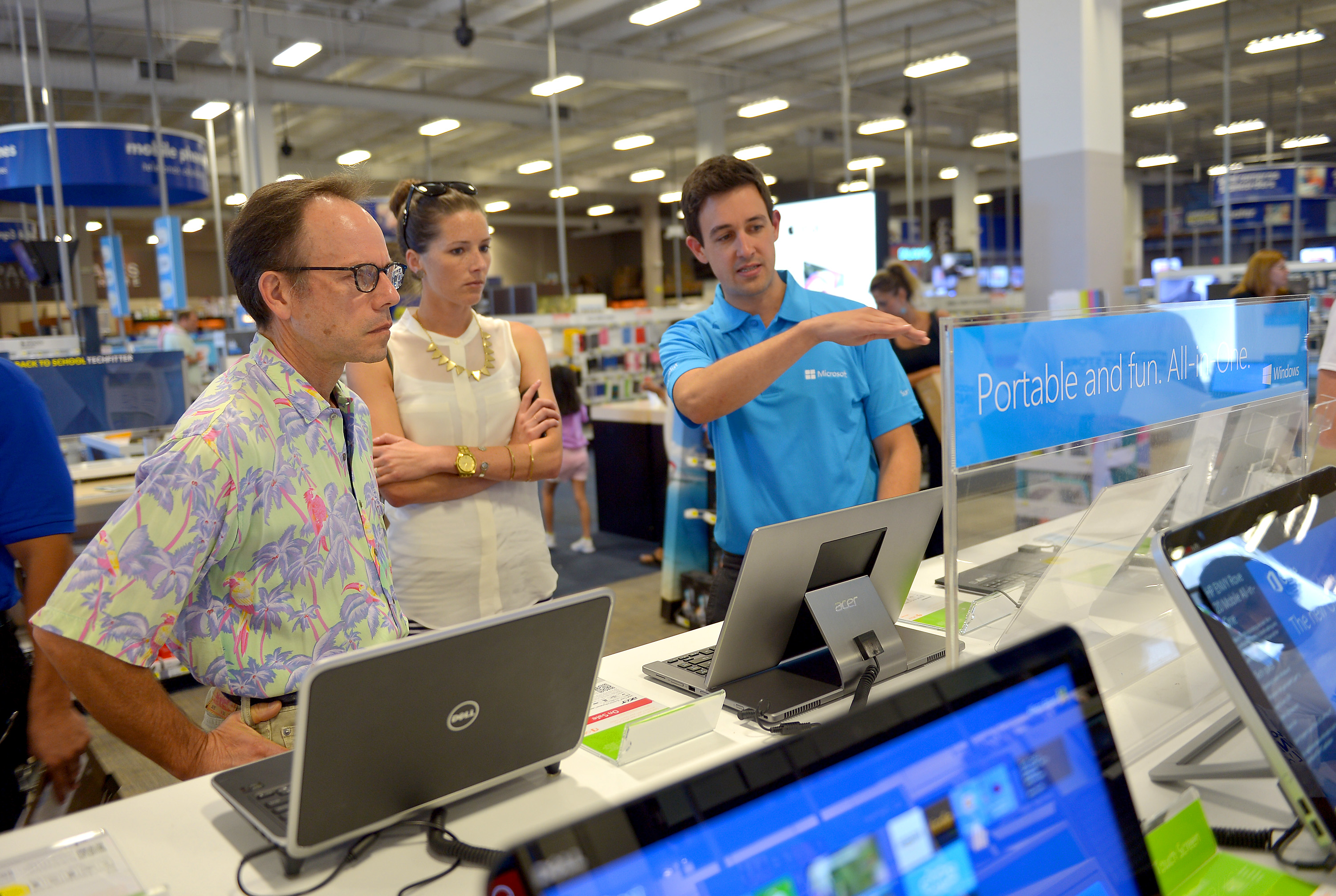 Excited customers check out the latest Windows 8 tech from Microsoft.