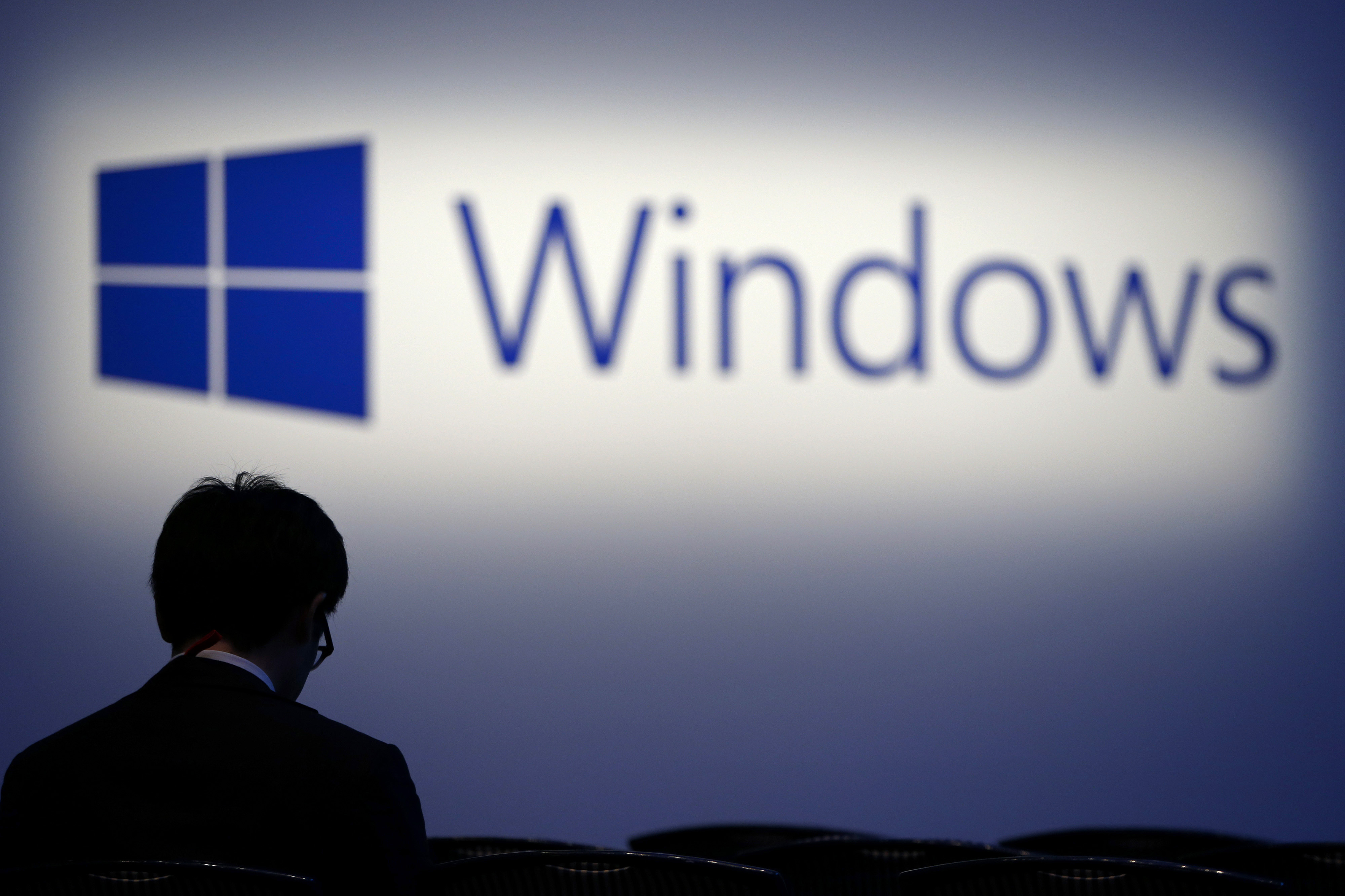 The logo for Microsoft Corp.'s Windows operating system is displayed at a launch event for the Windows 8.1 operating system in Tokyo, Japan, on Friday, Oct. 18, 2013.