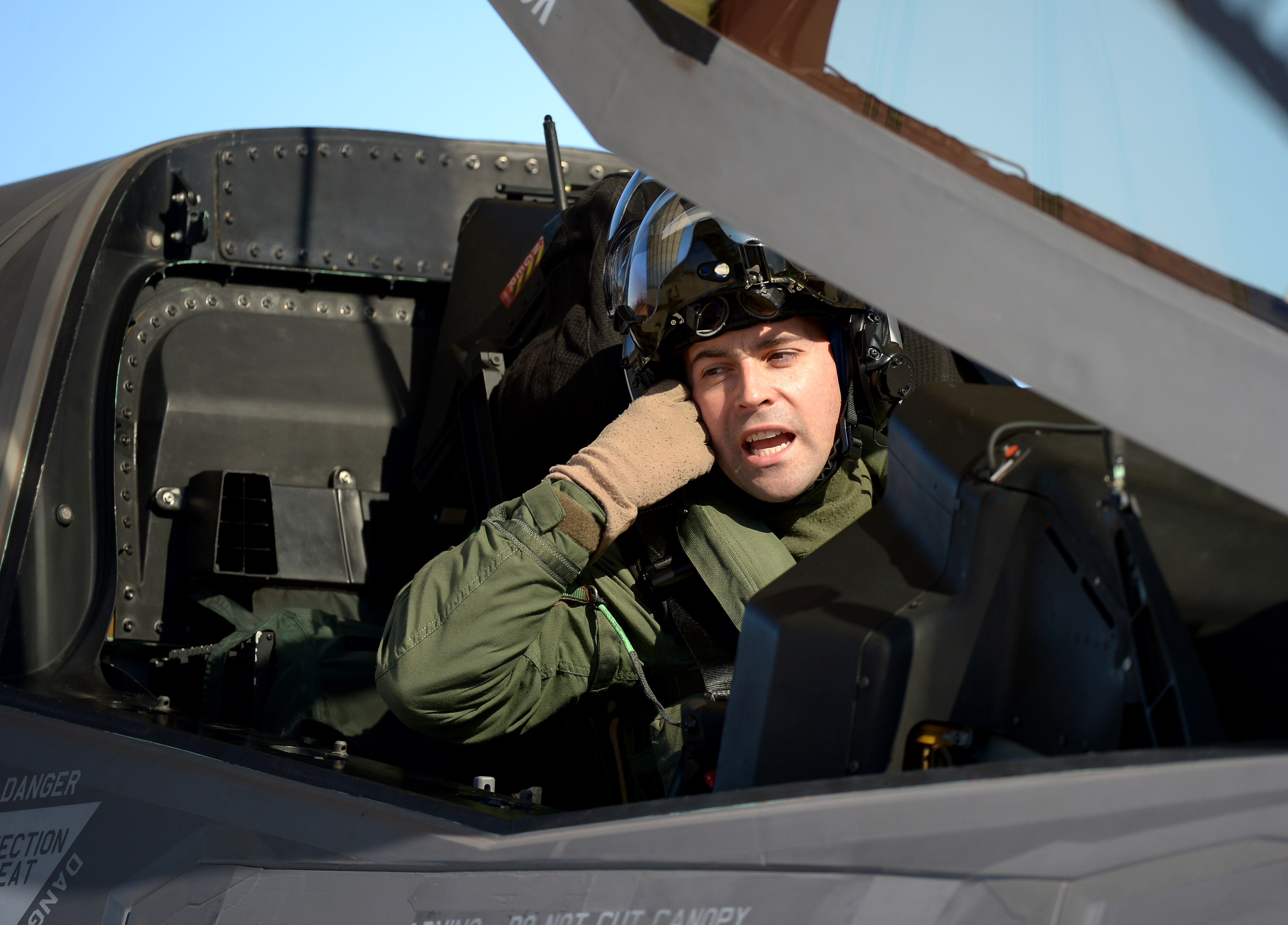 U.S. Marine Corps test pilot Maj. Richard Rusnok goes over his pre-flight check list in the cockpit of the  F-35B Lightning II aircraft BF-4p prior to a test flight at Naval Air Station Patuxent River on March 7, 2013 in Patuxent, MD