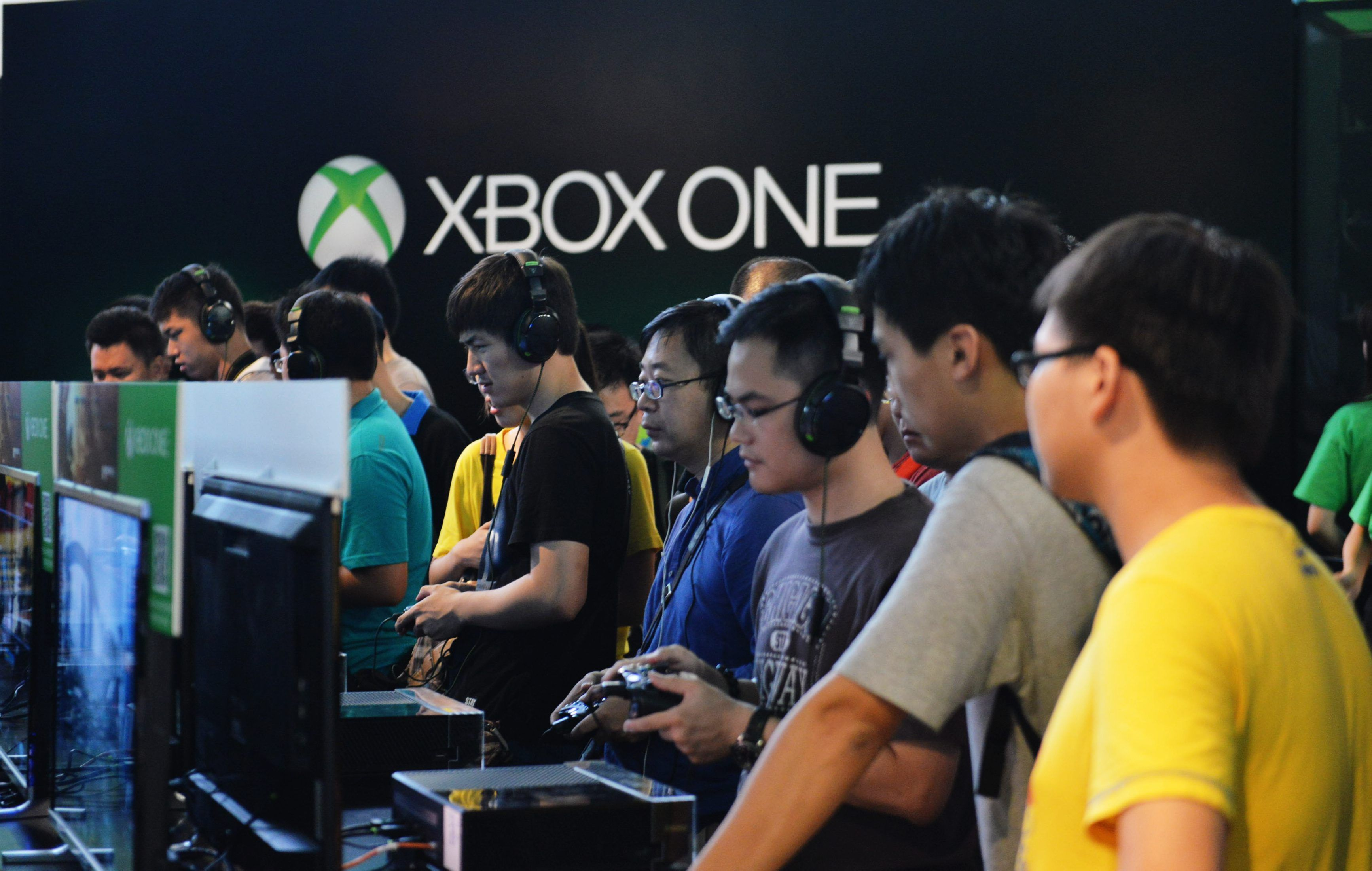 Visitors experience the Xbox One game during the China Joy event on July 31, 2014 in Shanghai, China.