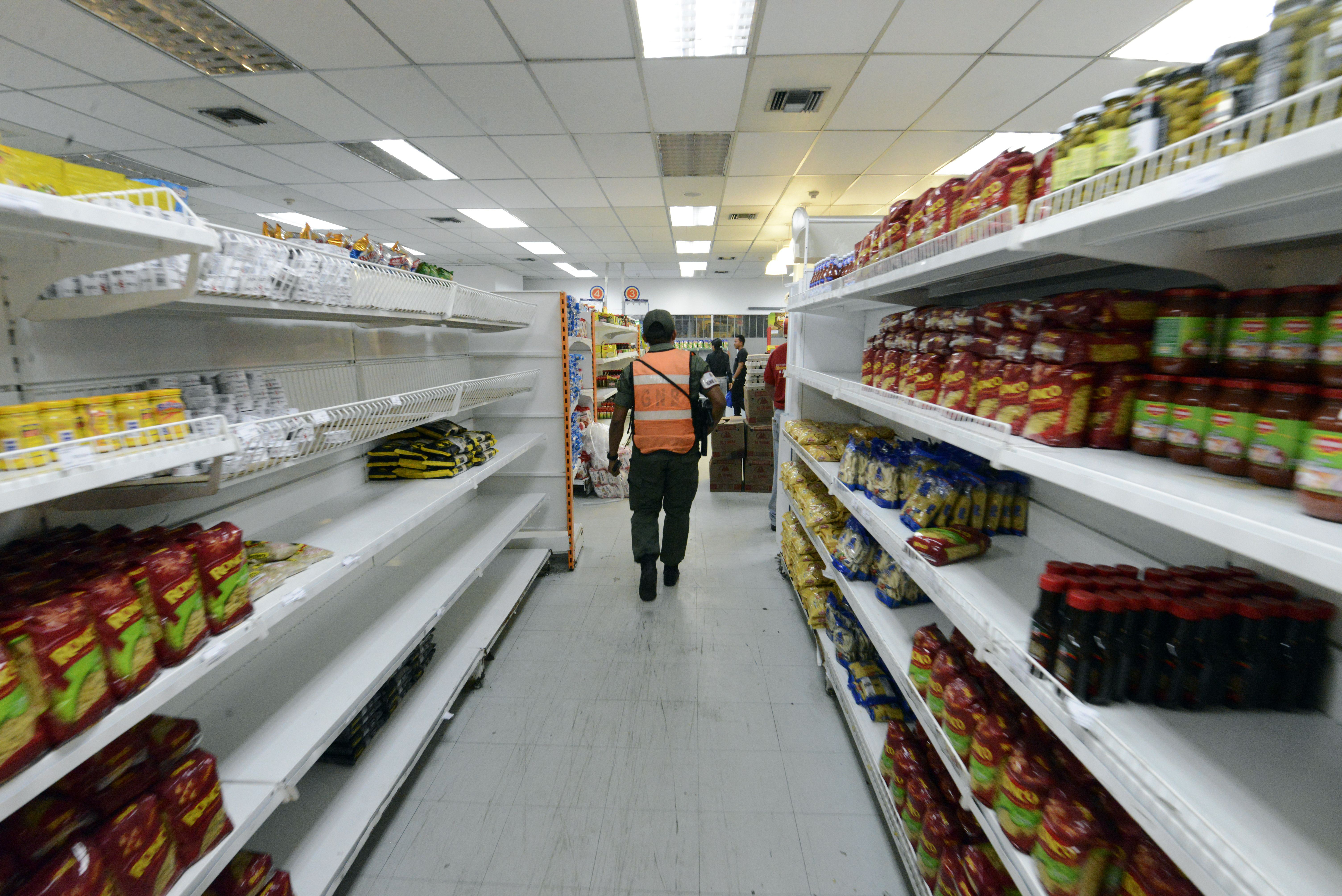 A member of the national guard patrols a supermarket in Caracas, Venezuela.
