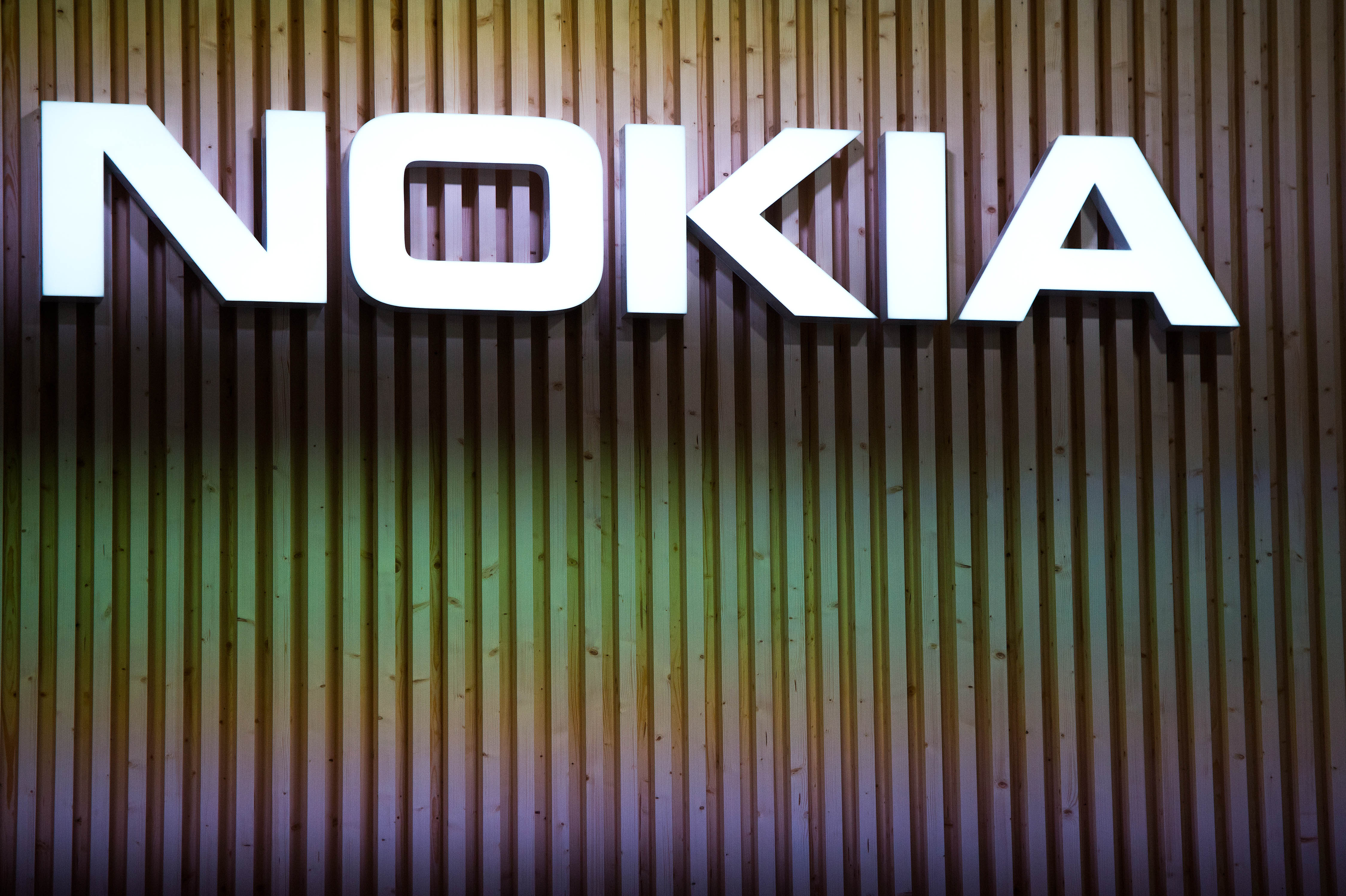 BARCELONA, SPAIN - MARCH 03:  A logo sits illuminated outside the Nokia pavilion during the second day of the Mobile World Congress 2015 at the Fira Gran Via complex on March 3, 2015 in Barcelona, Spain. The annual Mobile World Congress hosts some of the wold's largest communication companies, with many unveiling their latest phones and wearables gadgets.  (Photo by David Ramos/Getty Images)