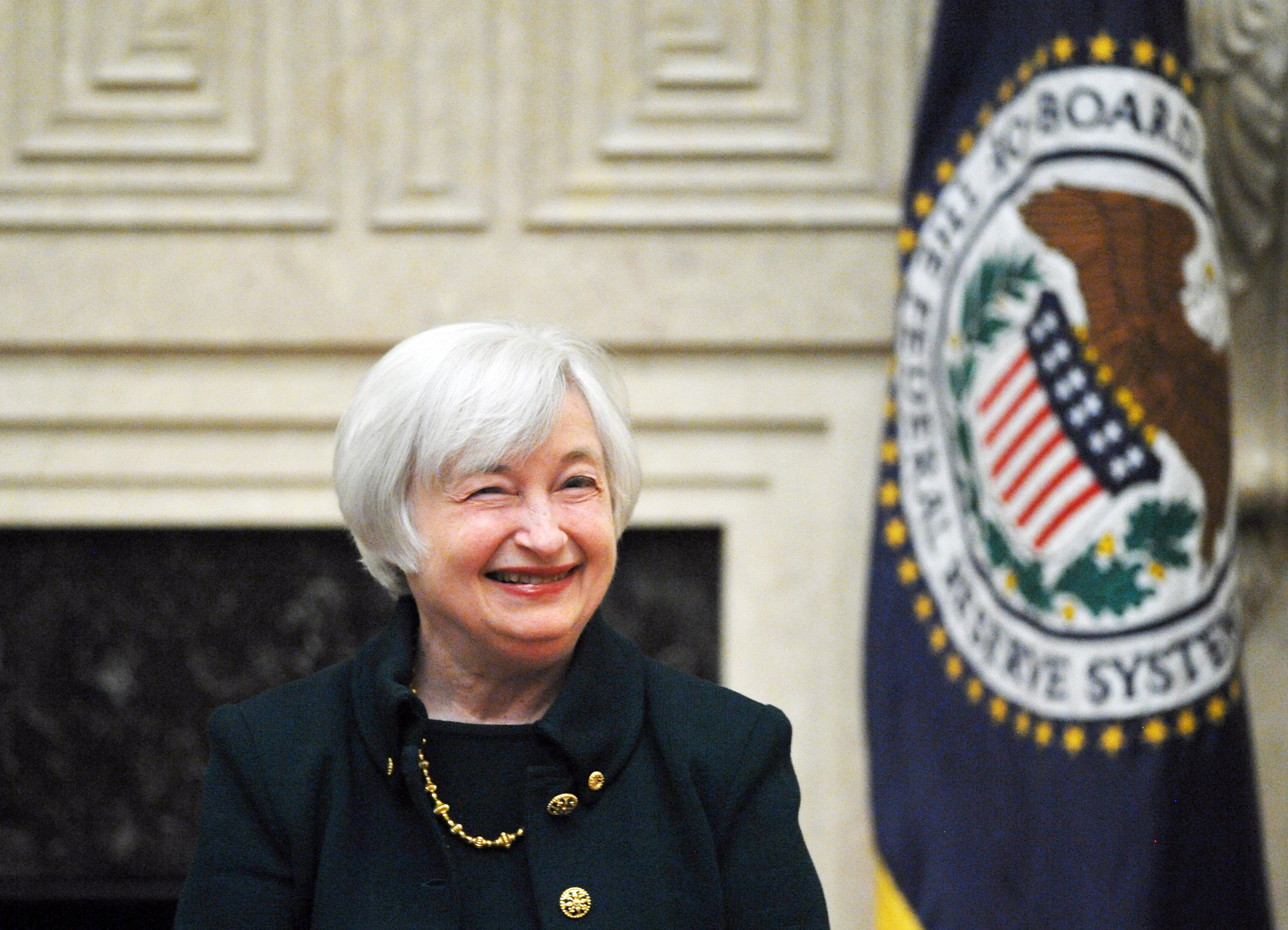 Janet Yellen smiles after taking the oath of office as Chairman of the Board of Governors of the Federal Reserve System February 3, 2014 at the Eccles Building in Washington, D.C.