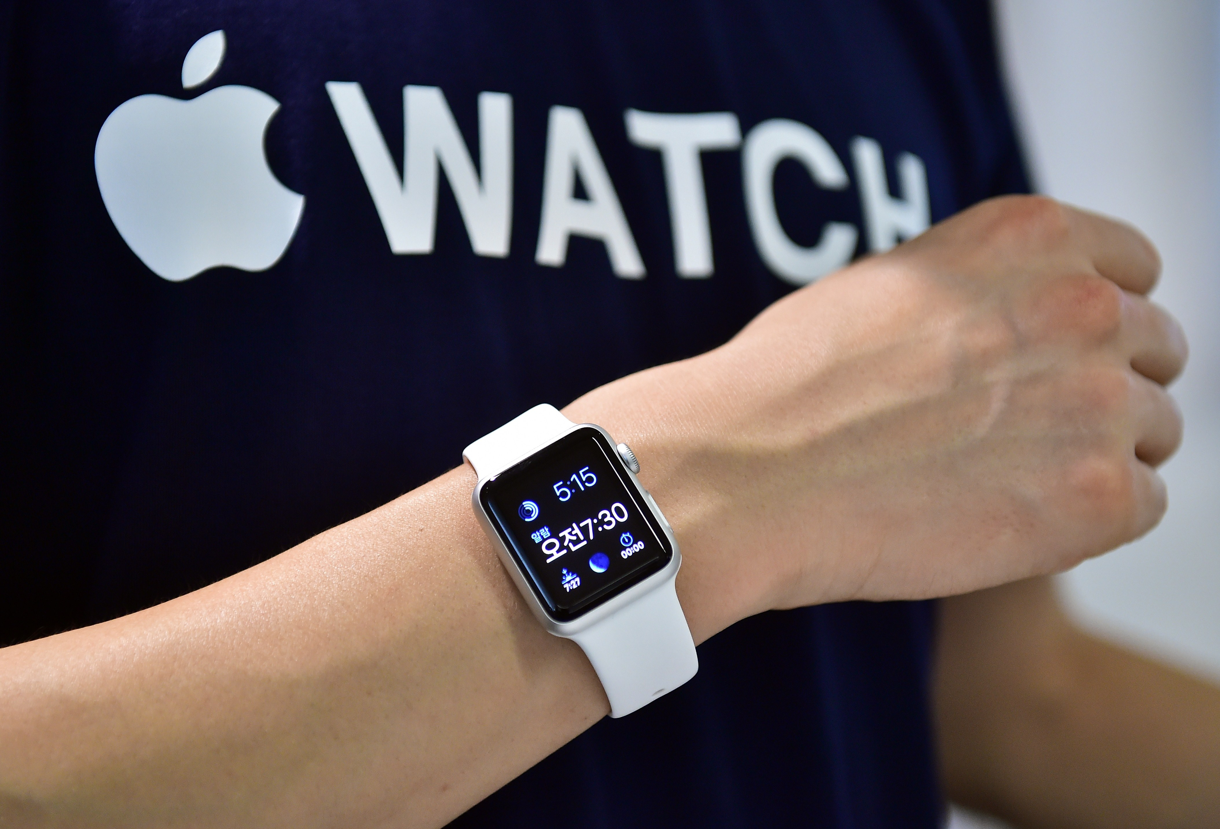 A South Korean employee shows the  Apple Watch  at an Apple shop in Seoul on June 26, 2015.