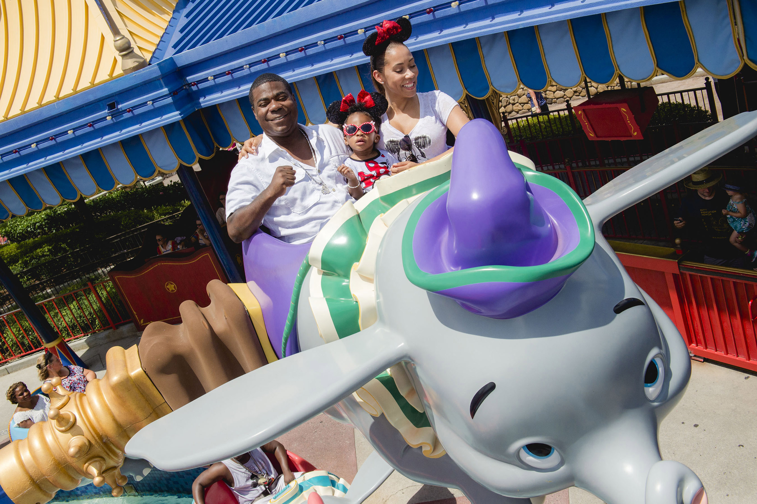 Actor-comedian Tracy Morgan, fiancee Megan Wollover and daughter Maven Morgan, 2, take flight July 2, 2015 on Dumbo the Flying Elephant at Magic Kingdom theme park