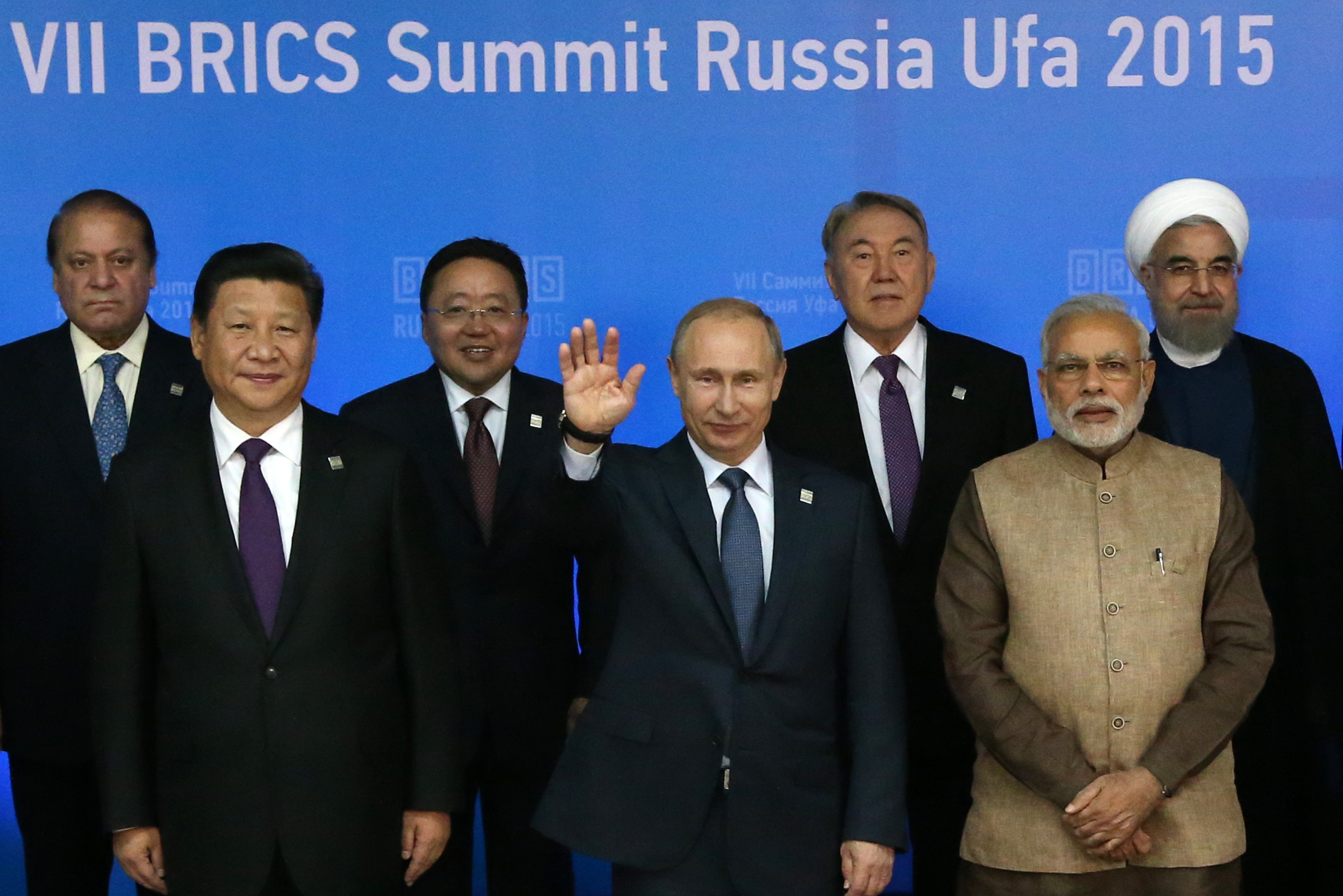 From left: Pakistani Prime Minister Muhammad Nawaz Sharif, Chinese President Xi Jinping, Mongolian President Elbegdorj Tsakhia, Russian President Vladimir Putin, Kazakh President Nursultan Nazarbayev, Indian Prime Minister Narendra Modi, Iranian President Hassan Rouhani pose for a photo during the BRICS 2015 Summit in Ufa, Russia, on July 9, 2015