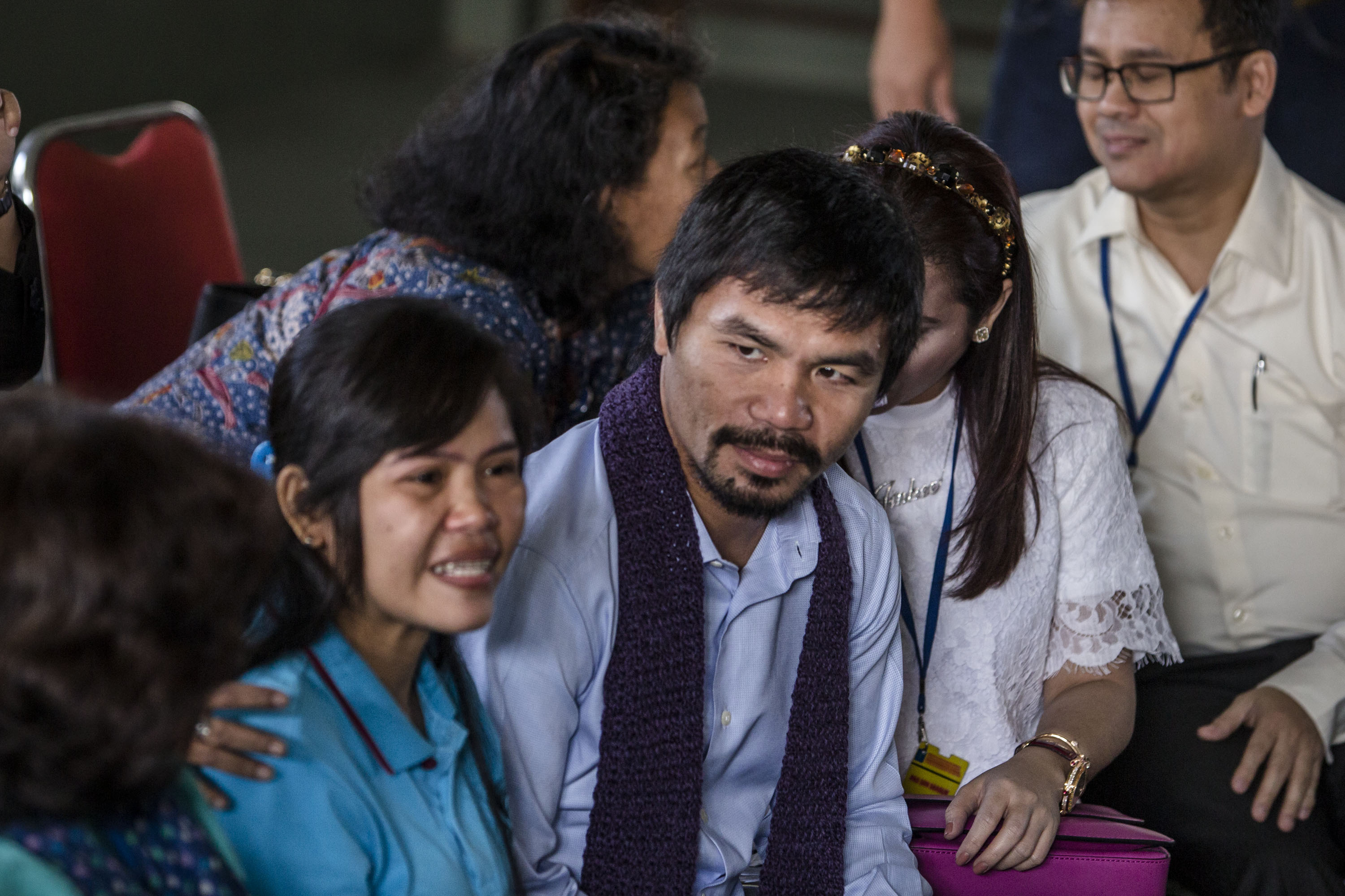 Filipino boxing icon Manny Pacquiao, center, and his wife Jinkee meet convicted drug trafficker Mary Jane Veloso of the Philippines during a visit at Wirogunan prison on July 10, 2015, in Yogyakarta, Indonesia
