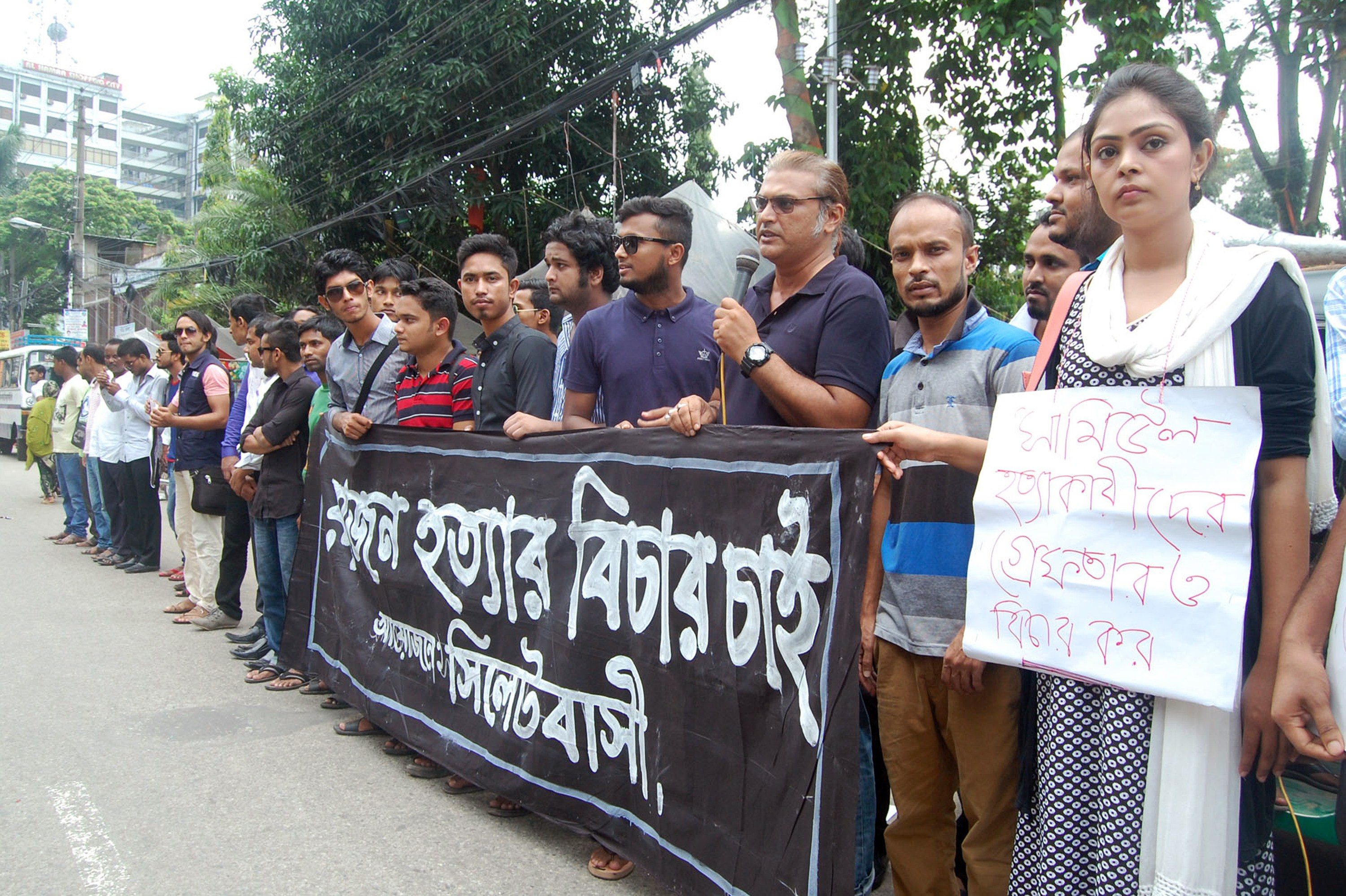 Bangladeshis protest against the beating death of a 13-year-old boy in Sylhet, Bangladesh, on July 13, 2015