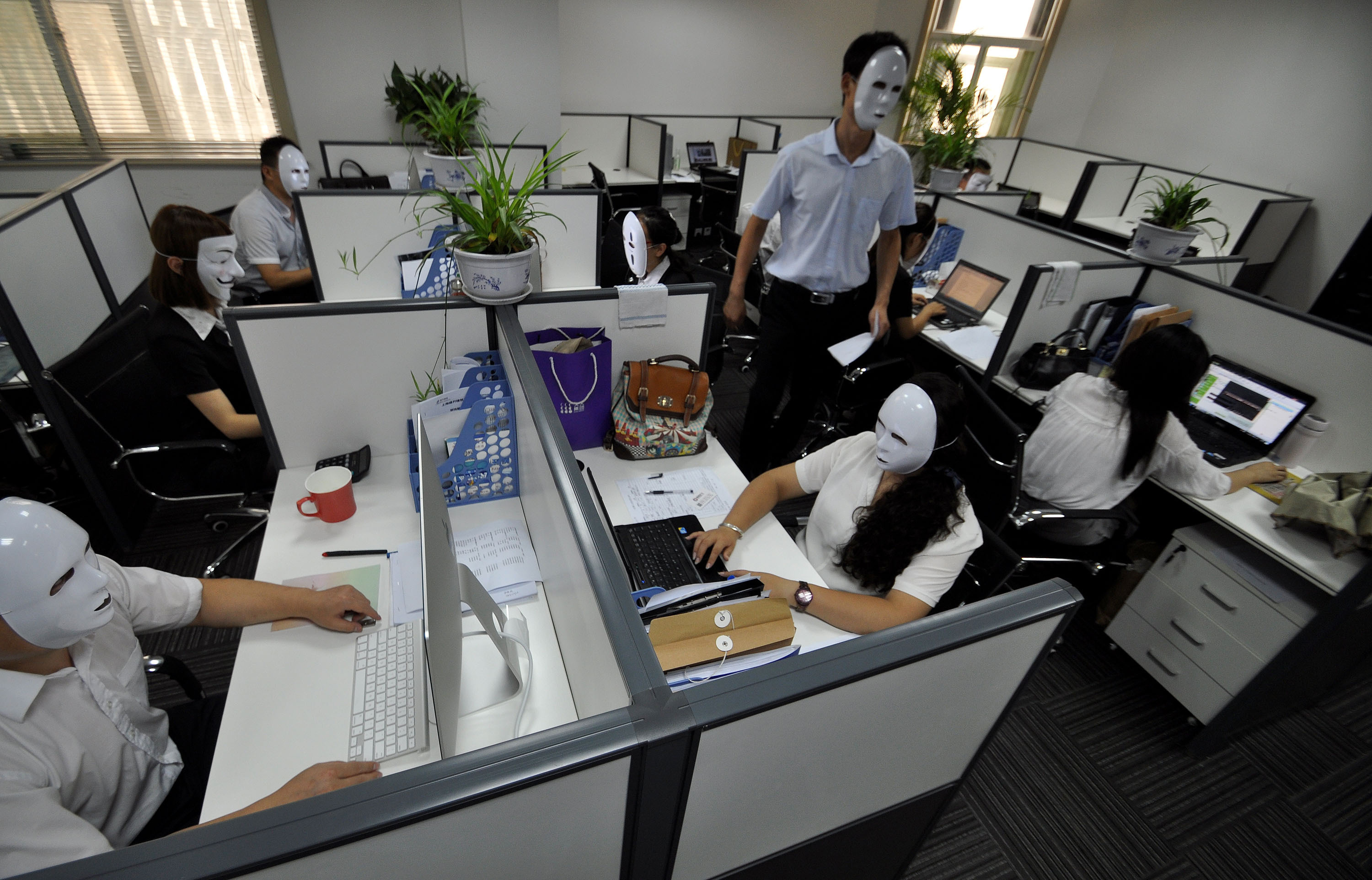 Chinese workers wearing no-face masks.
