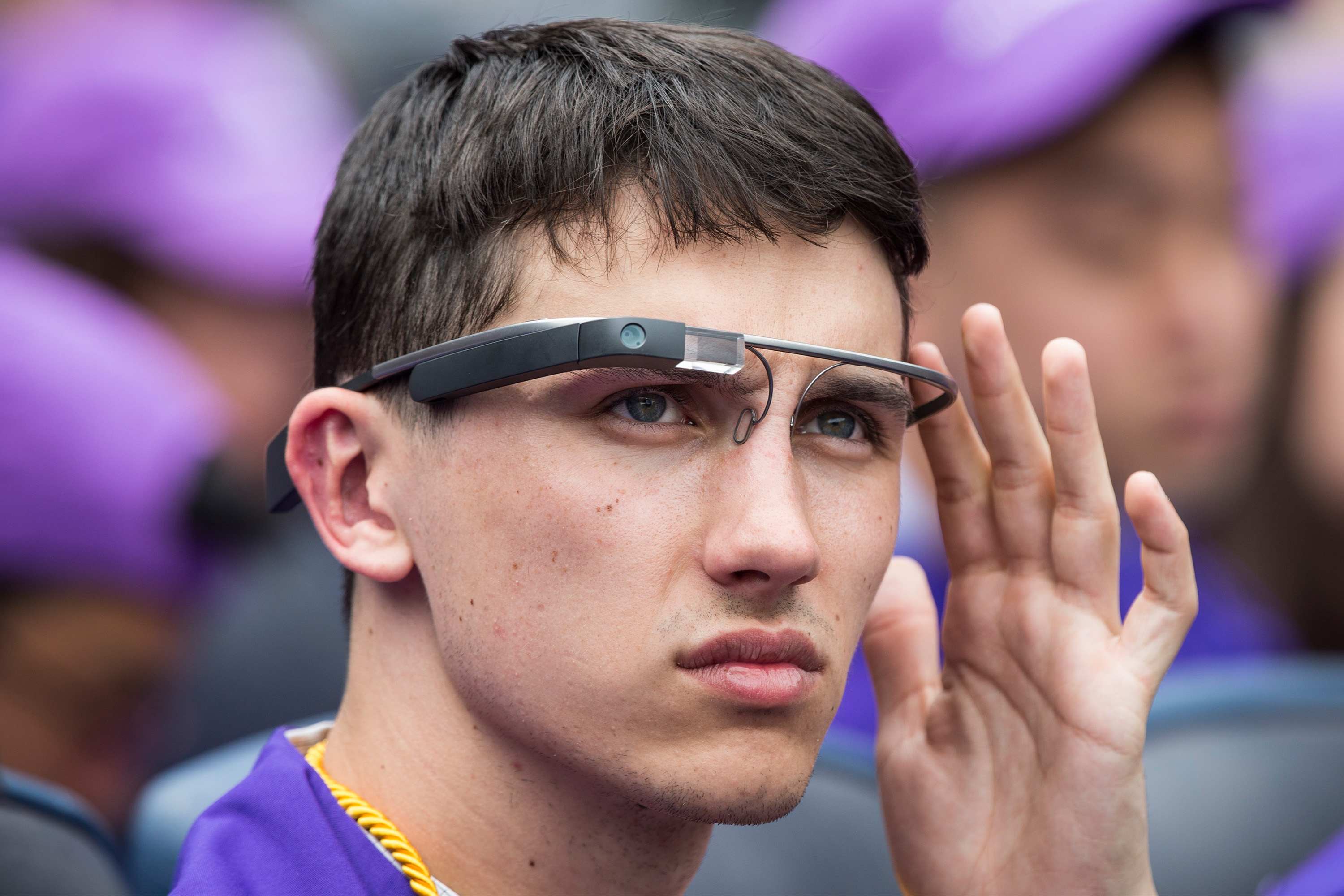 A student wears Google Glass at the 2014 New York University graduation ceremony at Yankee Stadium on May 21, 2014 in the Bronx borough of New York City.