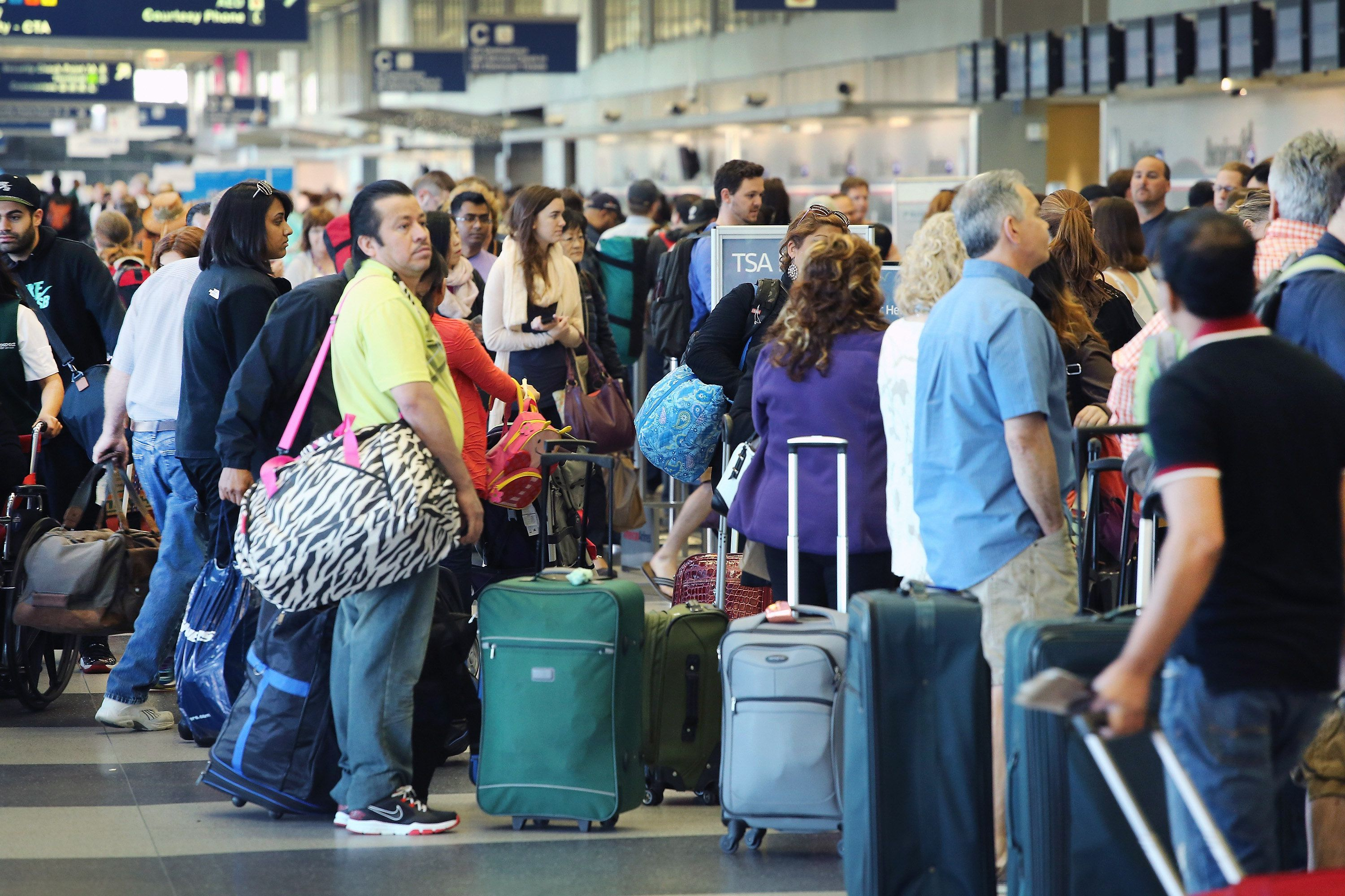 Passengers wait in line at a security checkpoint at O'Hare Airport in Chicago.