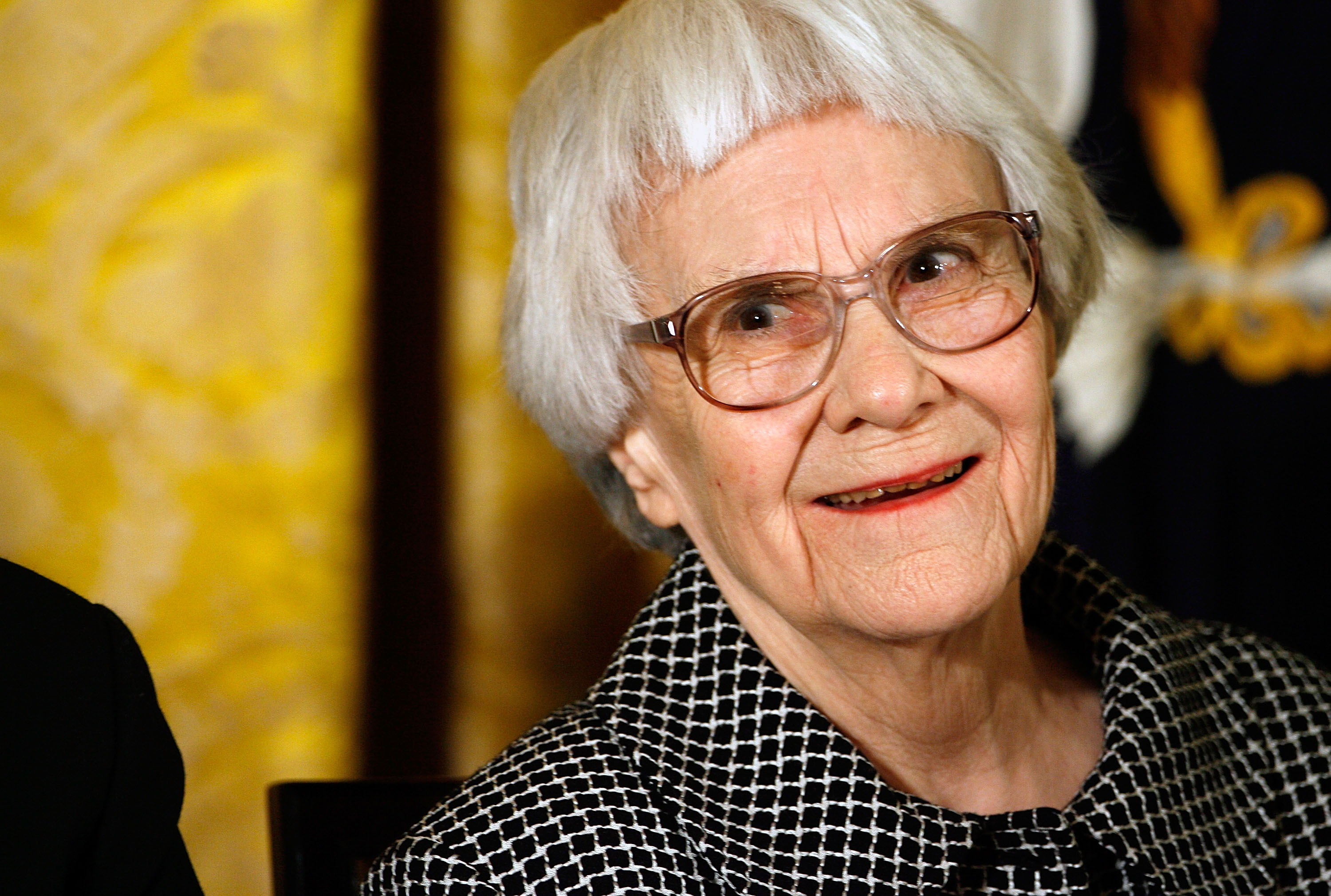 Pulitzer Prize winner and 'To Kill A Mockingbird' author Harper Lee smiles before receiving the 2007 Presidential Medal of Freedom in the East Room of the White House November 5, 2007 in Washington, DC