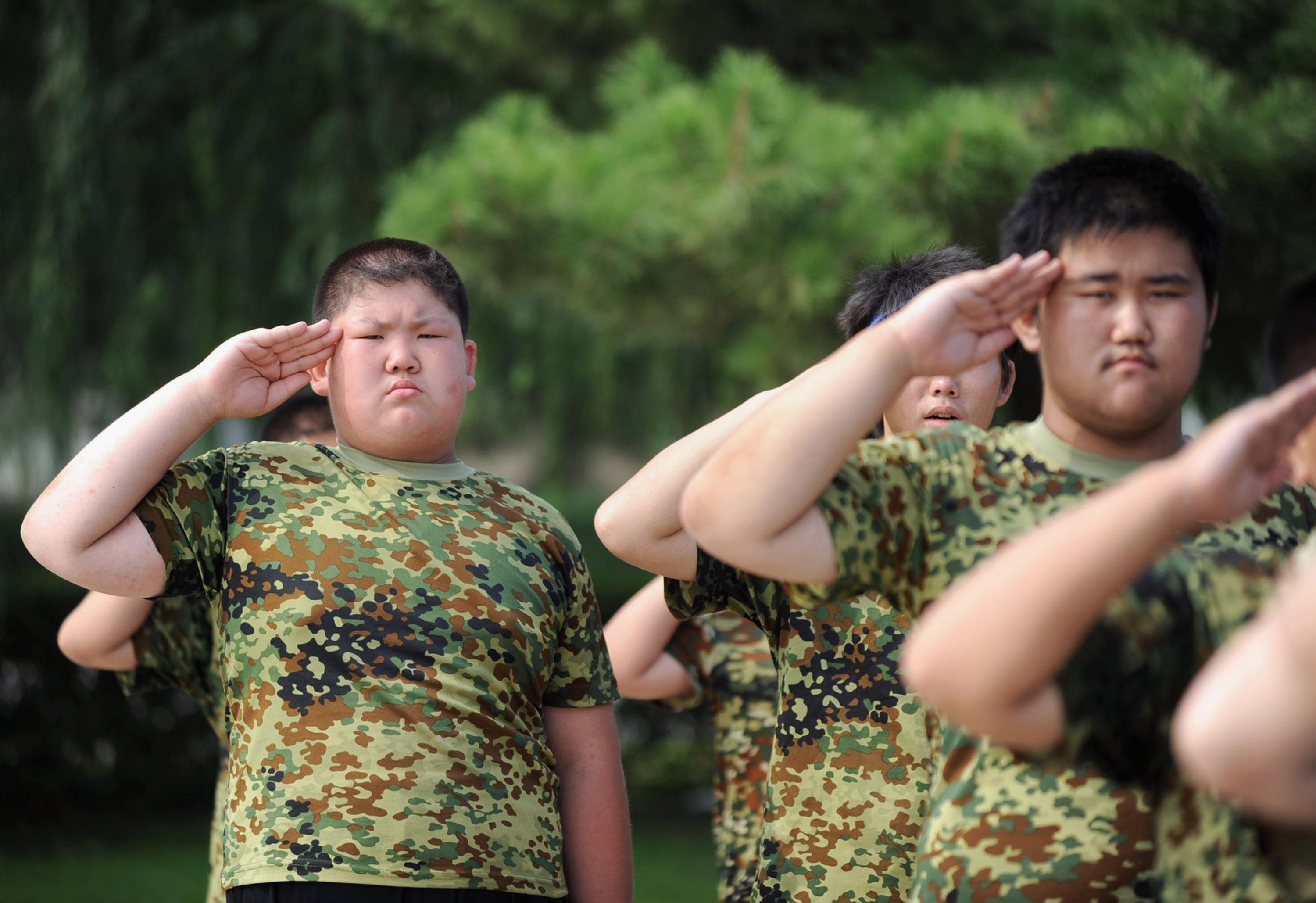 Overweight students attend military training during a weight-loss summer camp on July 30, 2009 in Shenyang of Liaoning Province, China.