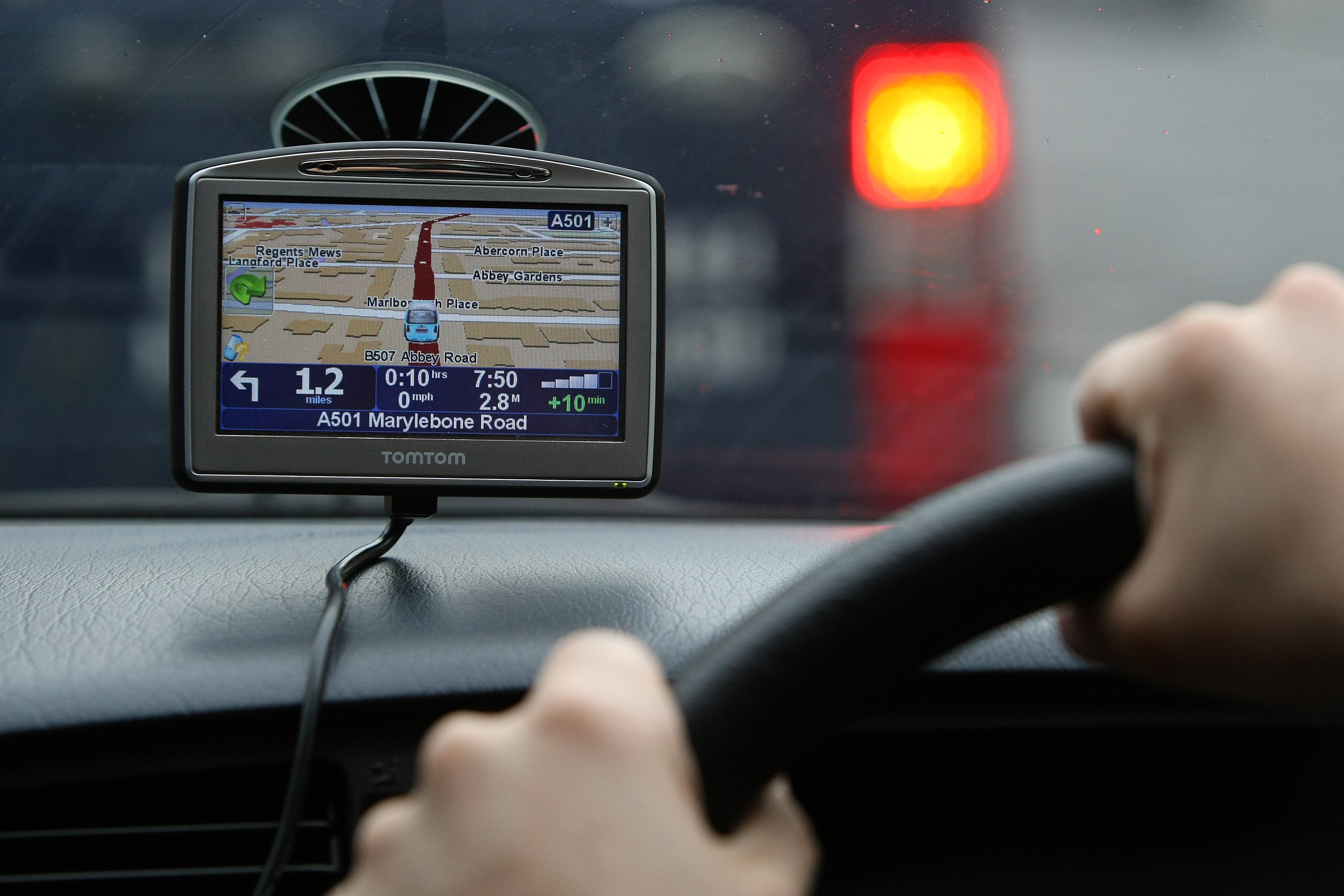 A driver uses a Tom Tom navigation device in central London, U.K., on Wednesday, April 23, 2008.