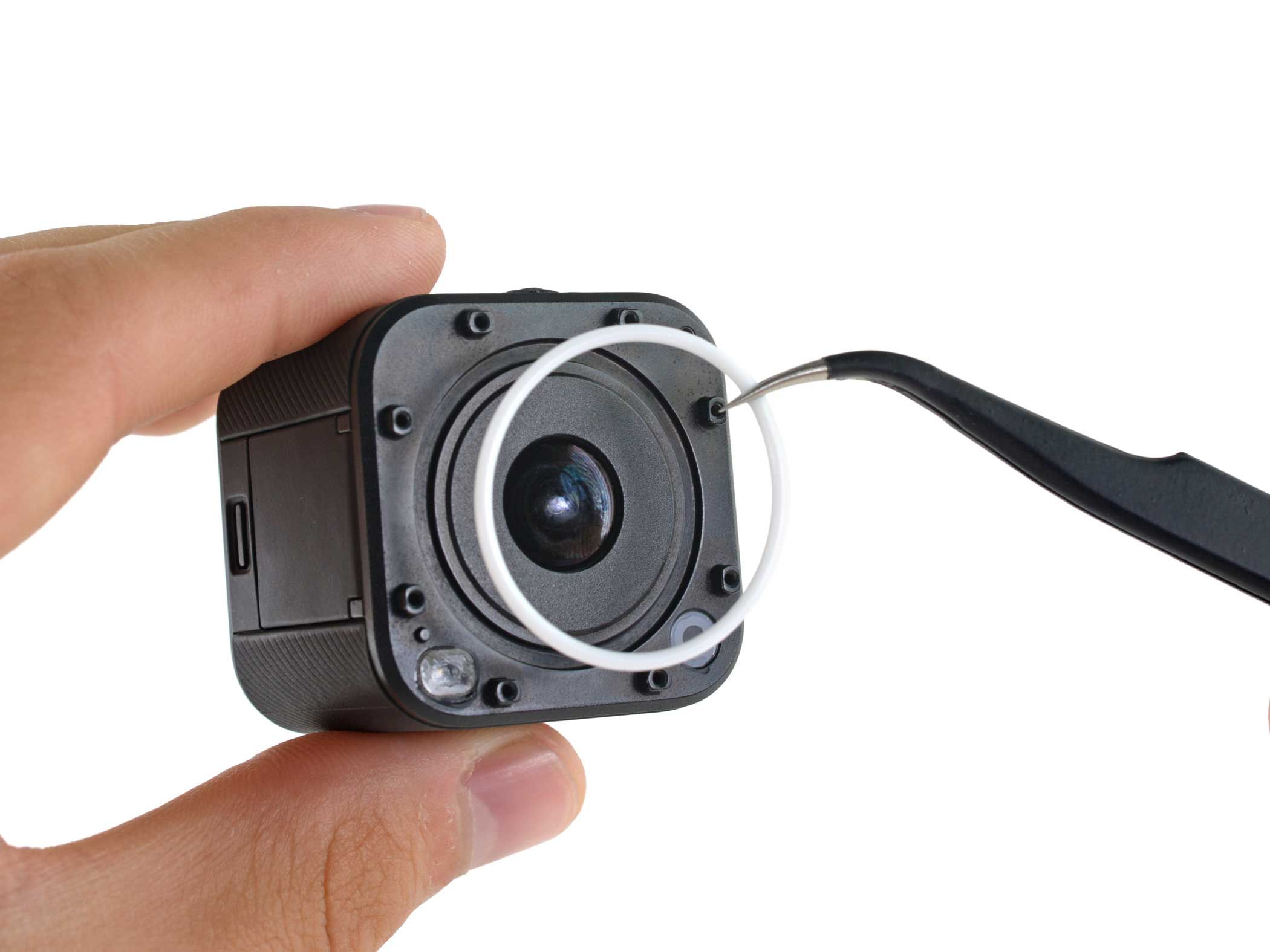 The GoPro HERO4 Session is carefully disassembled.