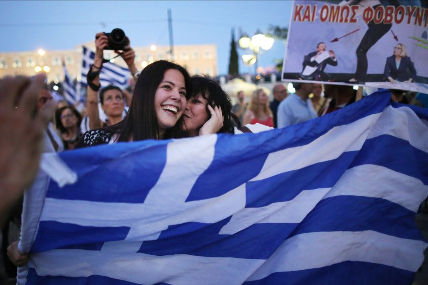 """People celebrate in front of the Greek parliament as early opinion polls predict a win for """"No"""" campaign, which won with more than 60 percent of the vote."""