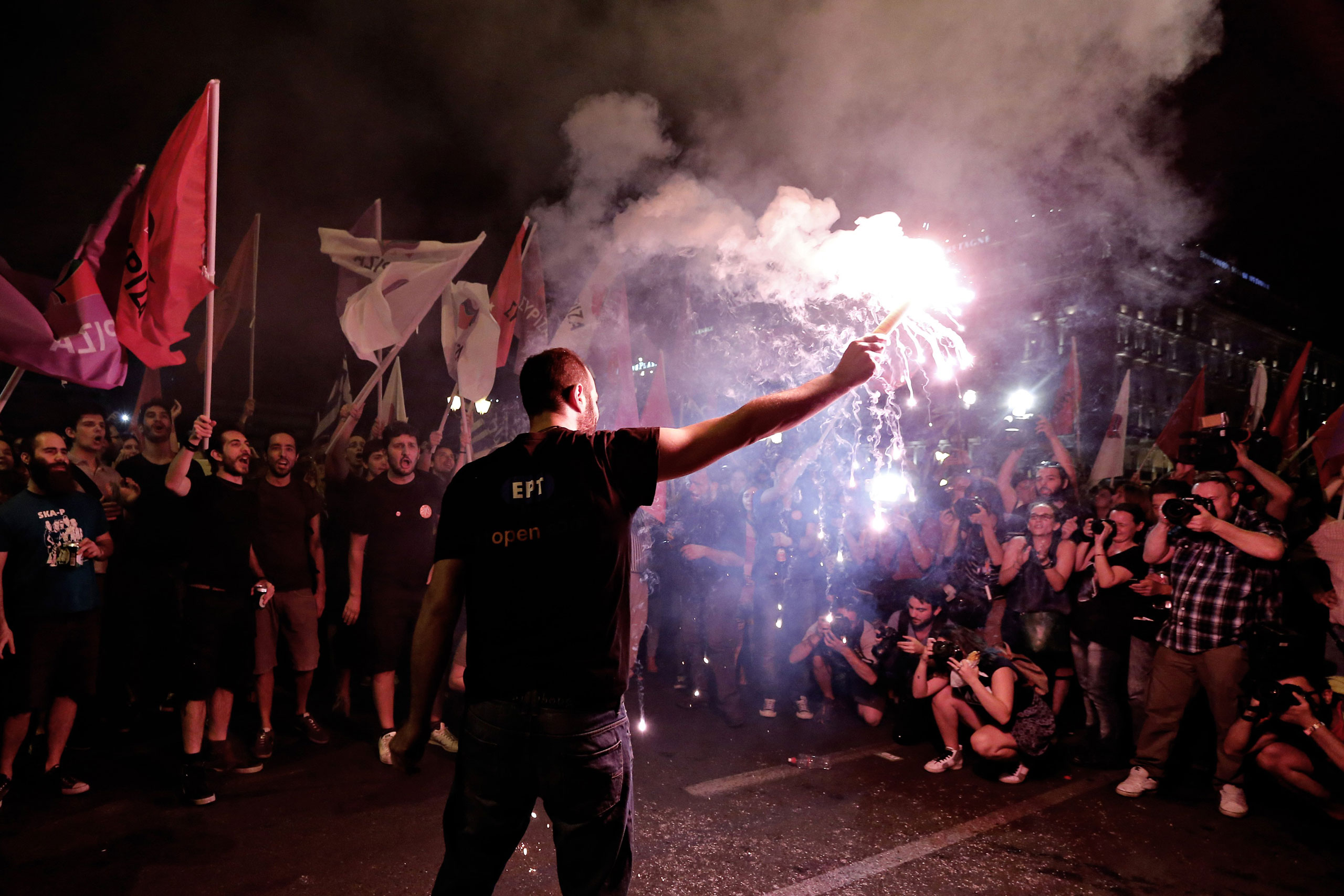 """No"" supporters celebrate the referendum results on a street in central in Athens on July 5, 2015."