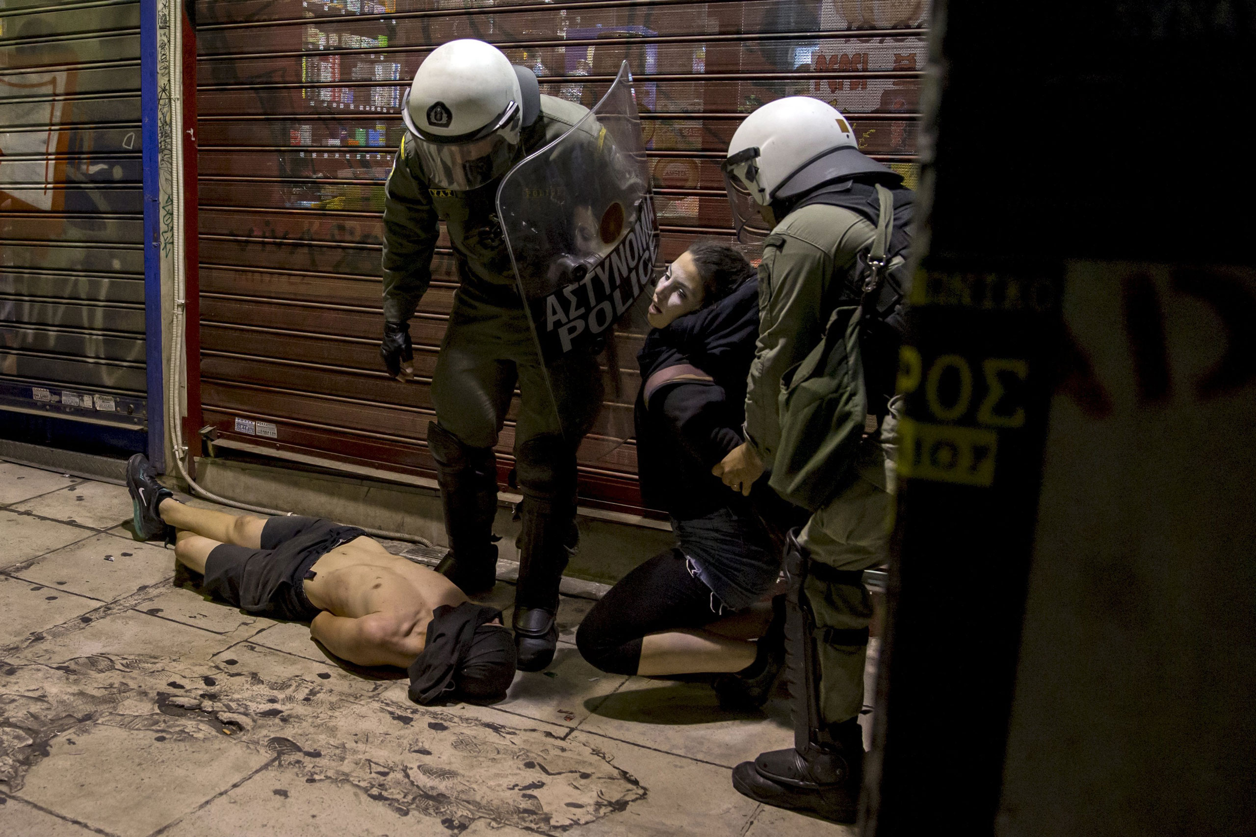 Riot police detaining masked youth during minor clashes in central Athens on July 6, 2015.