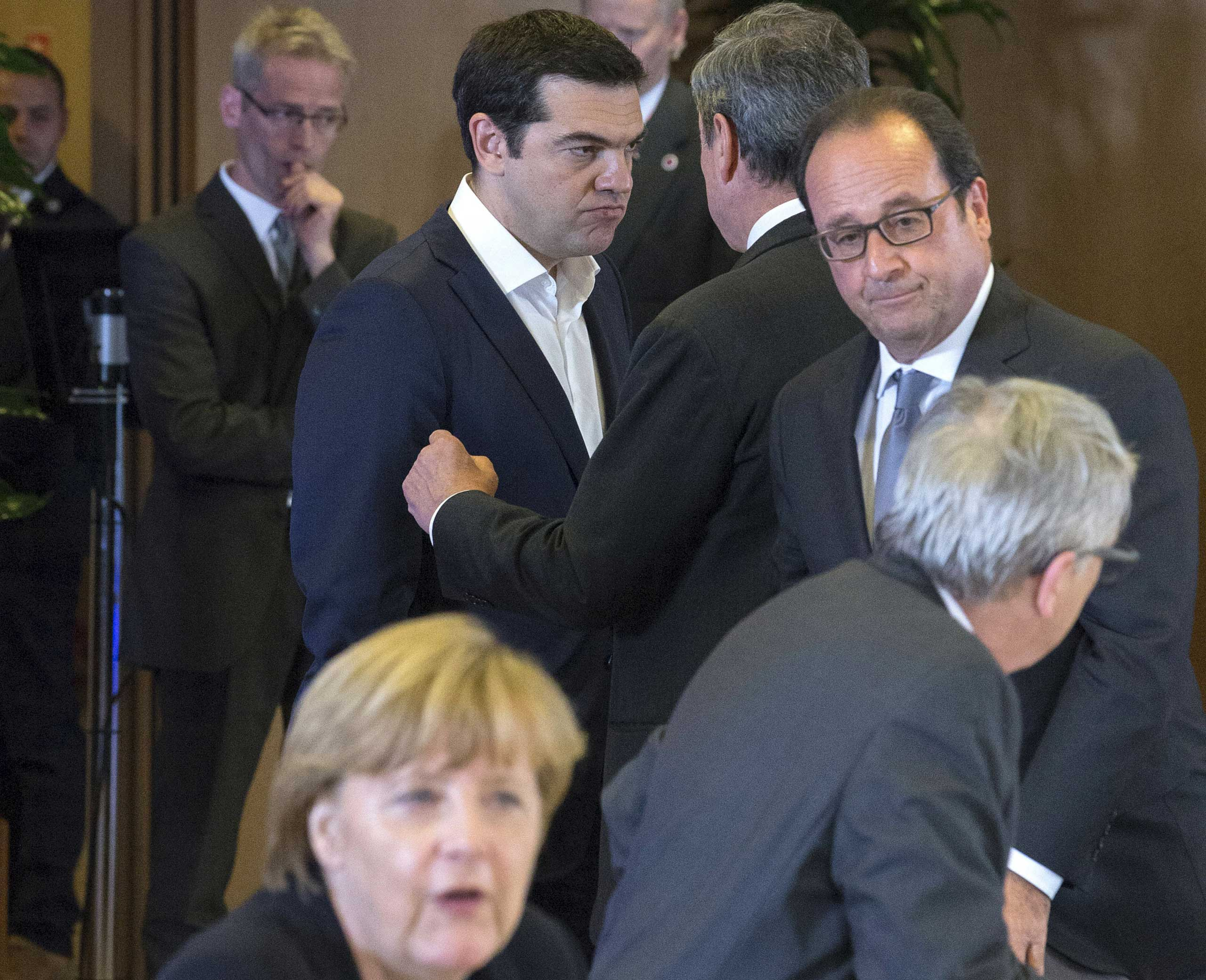 German Chancellor Angela Merkel, Greek Prime Minister Alexis Tsipras, European Central Bank President Mario Draghi, French President Francois Hollande and European Commission President Jean Claude Juncker take part in a euro zone EU leaders emergency summit on the situation in Greece in Brussels, on July 7, 2015.