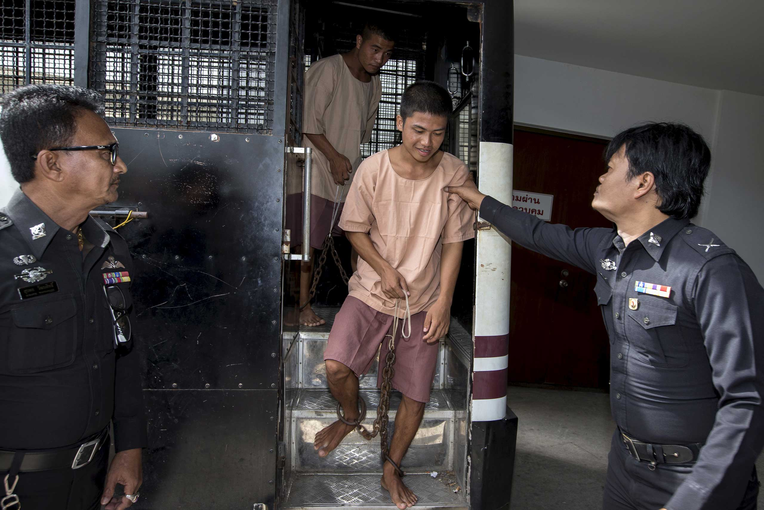 Burmese migrant workers Wai Phyo and Zaw Lin arrive at the Koh Samui Provincial Court, in Koh Samui, Thailand, on July 8, 2015