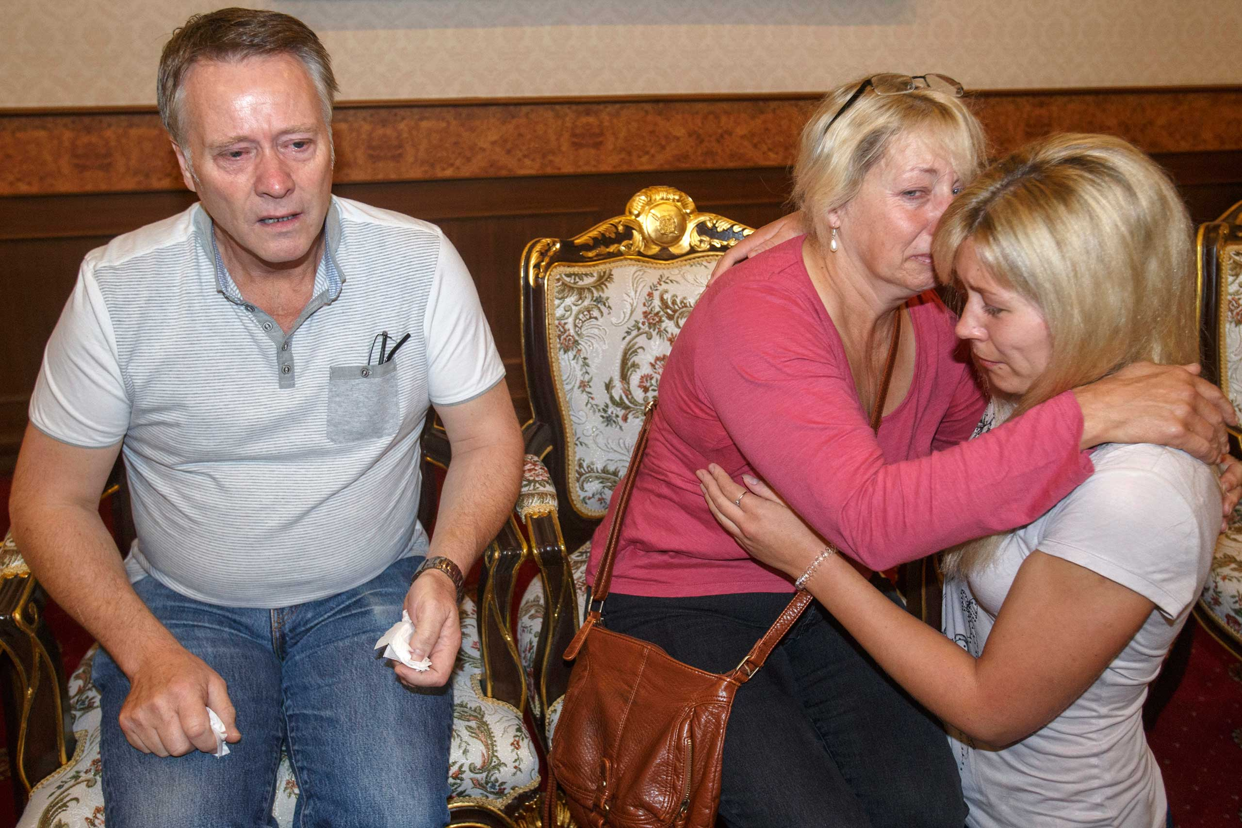 Family members of Hannah Witheridge comfort one another at the headquarters of the Royal Thai Police in Bangkok, on Sept. 18, 2014