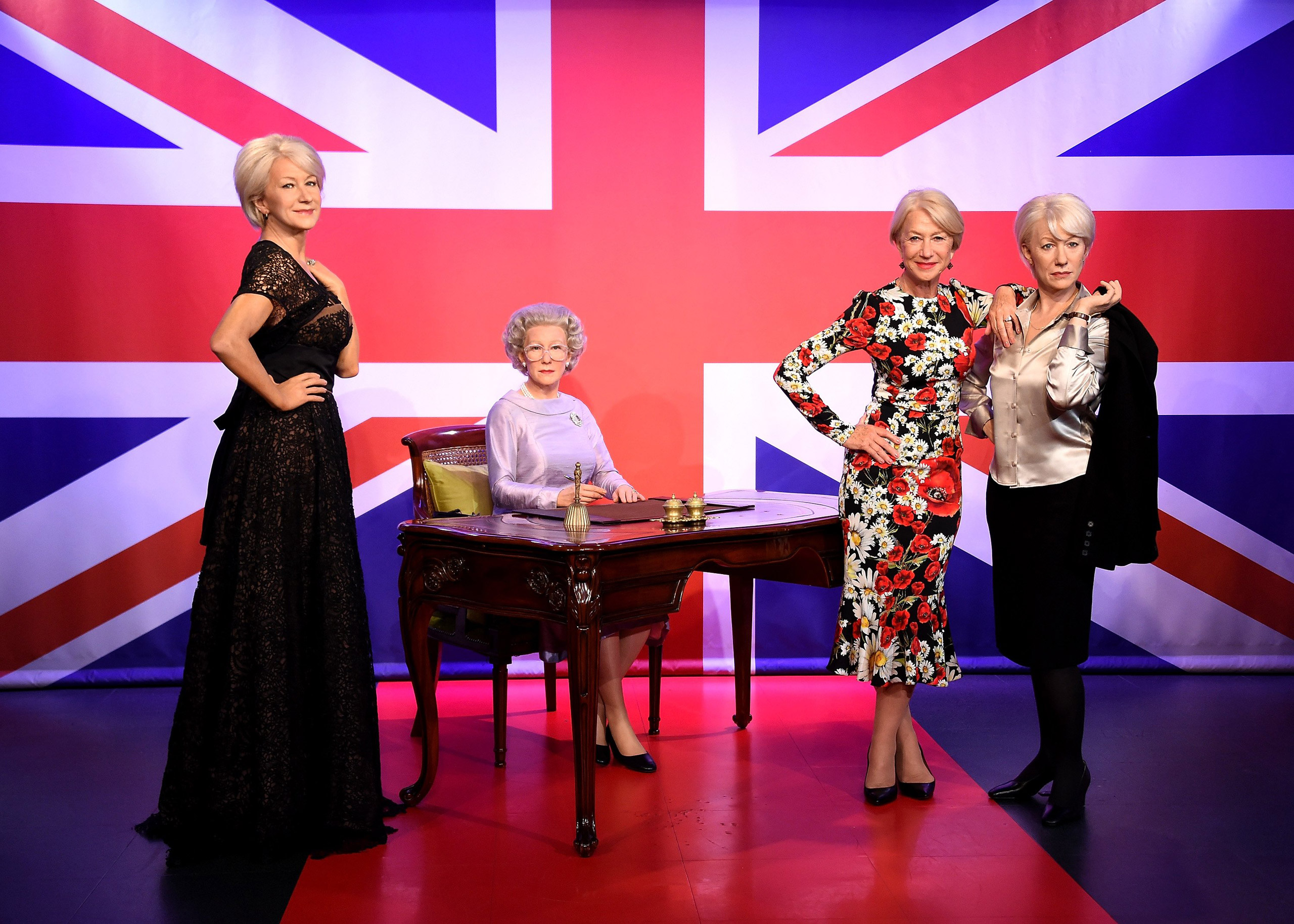 Helen Mirren meets her 3 wax figures at Madame Tussauds on July 30, 2015 in London.