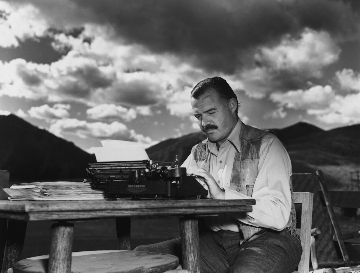Ernest Hemingway works at his typewriter while sitting outdoors, in Idaho on Oct. 7, 1939