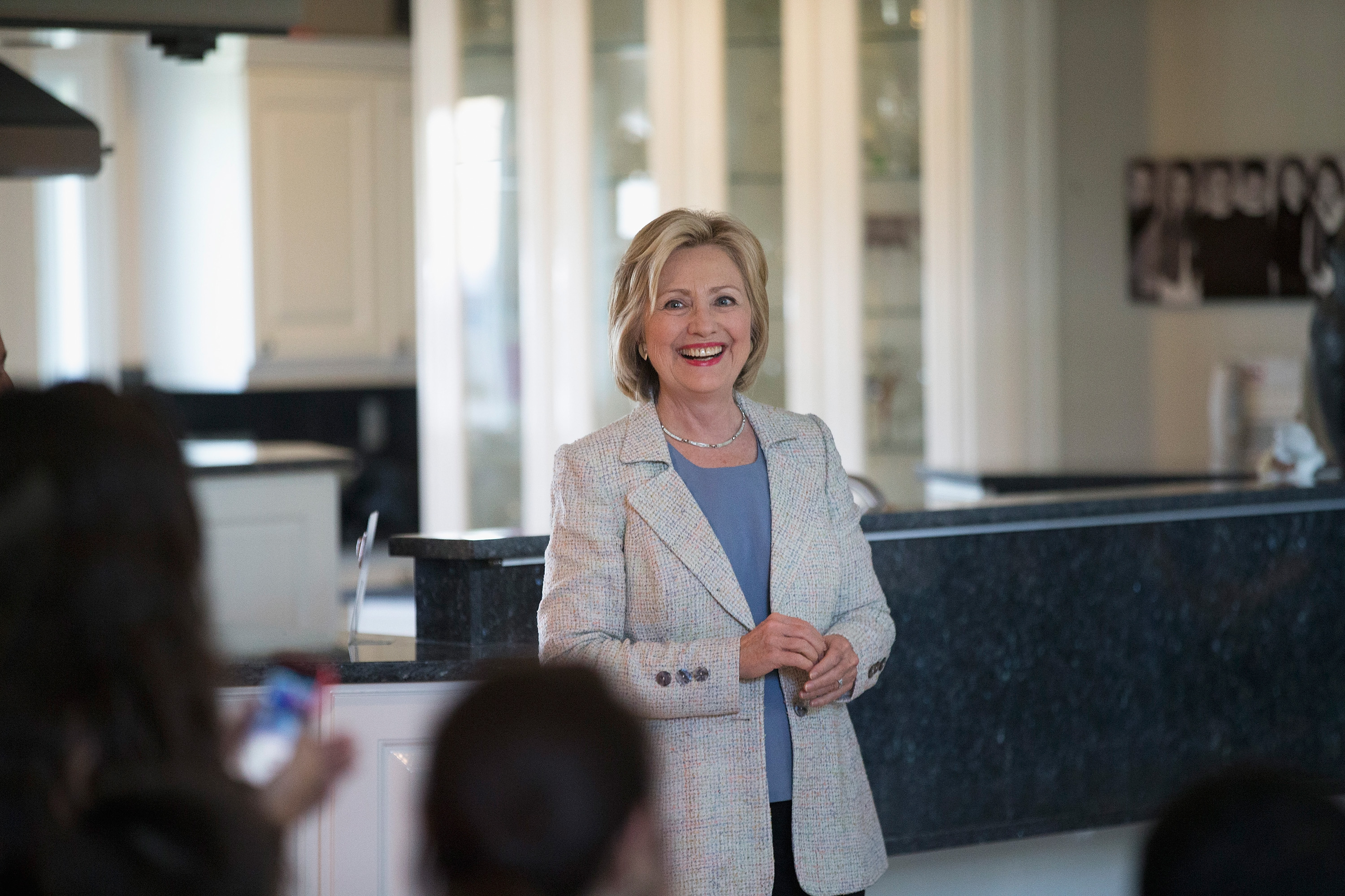 Democratic presidential hopeful and former Secretary of State Hillary Clinton waits to be introduced at a house party on July 26, 2015 in Carroll, Iowa.