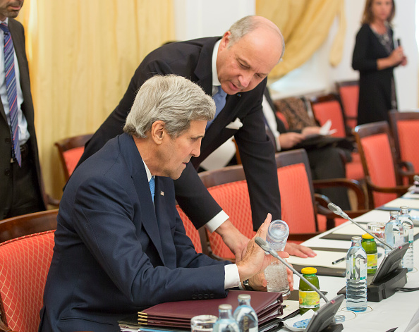 Foreign Minister of France Laurent Fabius (R) talks with U.S. Secretary of State John Kerry during the nuclear talks between the E3+3 (France, Germany, UK, China, Russia, US) and Iran in Vienna, Austria on July 06, 2015.