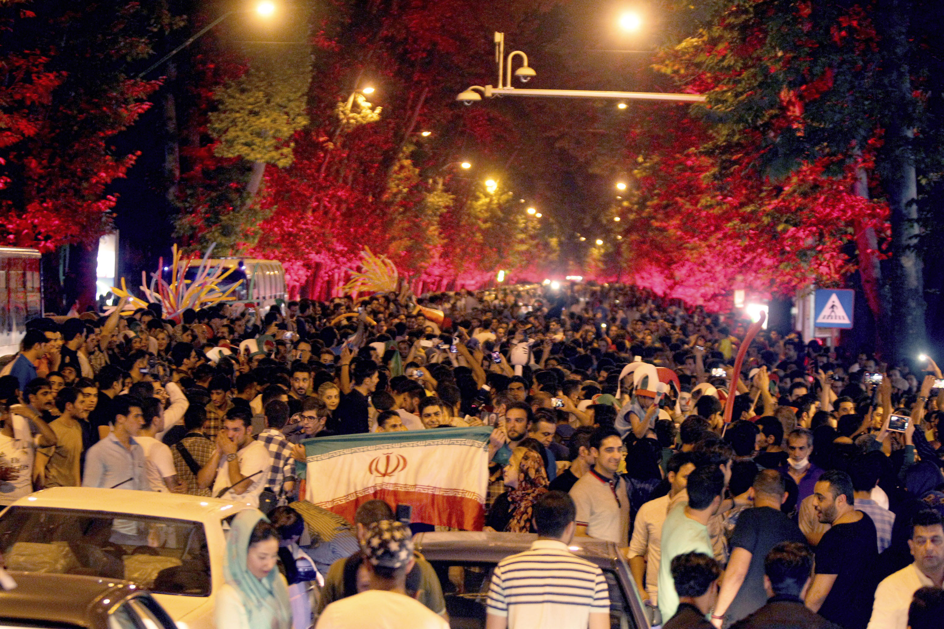 Iranians take to the streets of Tehran on July 14 to celebrate their country's historic nuclear accord.