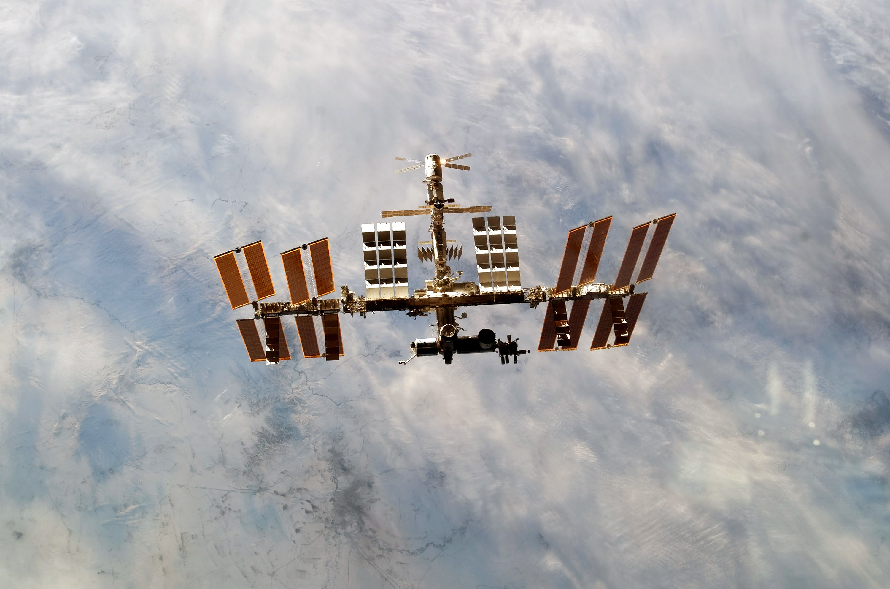 The International Space Station is seen from the space shuttle Discovery as the two orbital spacecraft accomplish their relative separation after an aggregate of 12 astronauts and cosmonauts worked together for over a week during flight day 12 activities on March 7, 2011 in Space.