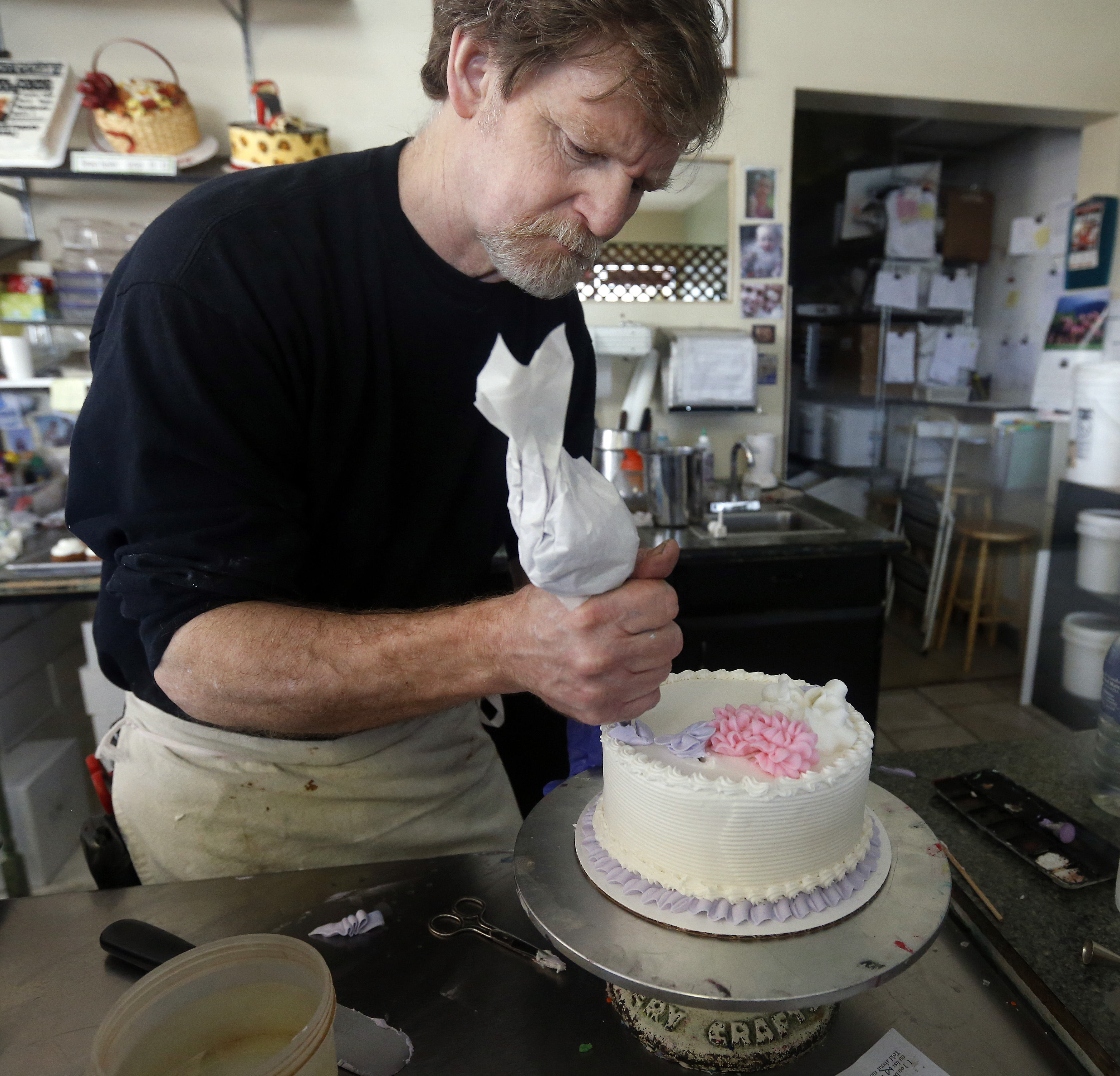 Masterpiece Cakeshop owner Jack Phillips decorates a cake inside his store, in Lakewood, Colorado, on March 14, 2010.