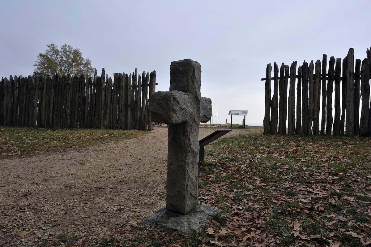 A stone cross marking the grave of a 17th-century British settler is seen at the archaeological site of Jamestown, Va., on November 22, 2011.
